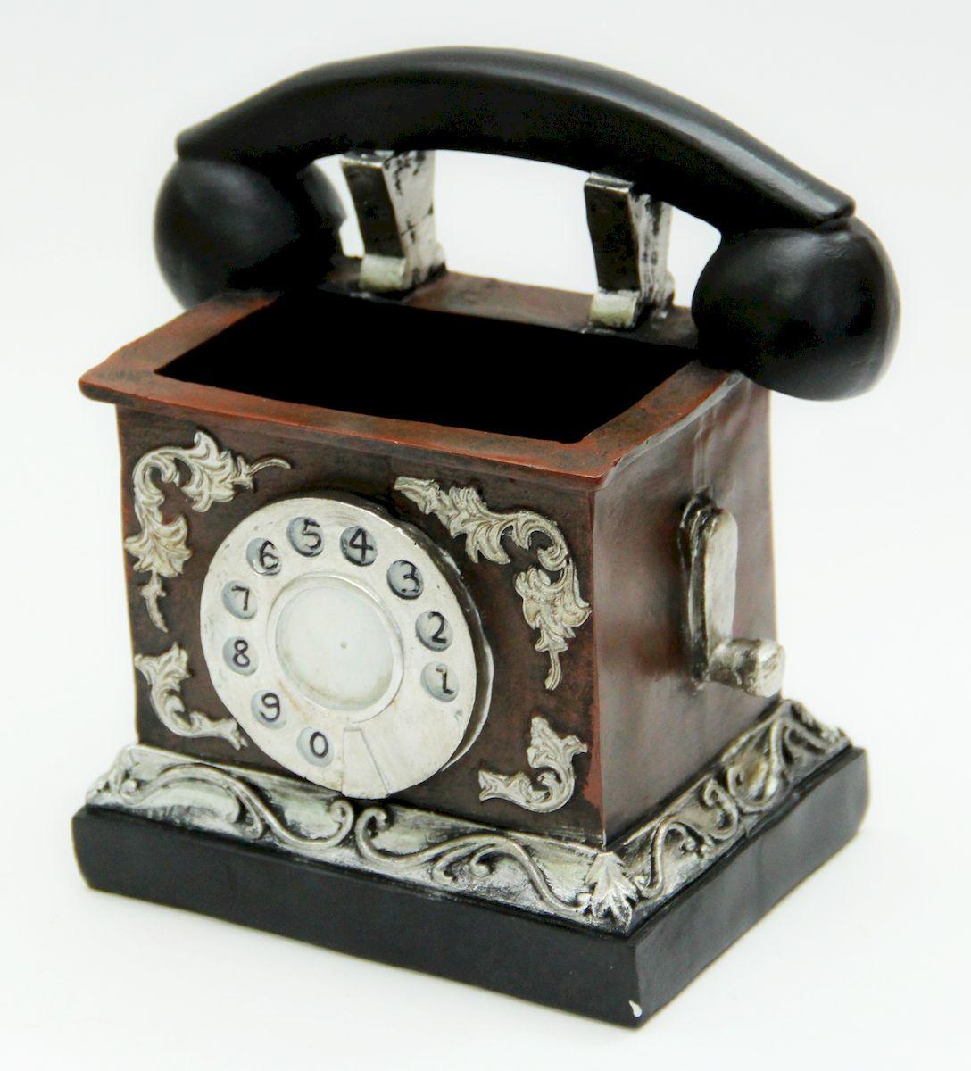 Подставка для канцелярских принадлежностей Magic Home Ретро телефон. 3613236132Оригинально выполненная подставка из прочного полирезина сохранит ваши канцелярские принадлежности, и они всегда будут под рукой. Благодаря эксклюзивному дизайну, подставка оформит ваш рабочий стол, а также станет практичным сувениром для друзей и коллег.