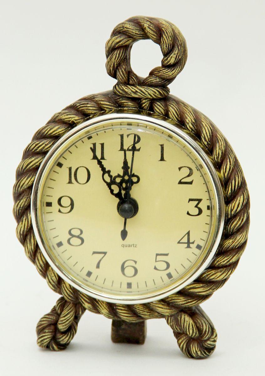 Часы настольные Magic Home Морской узел, цвет: бронзовый41058Настольные кварцевые часы Magic Home Морской узел изготовлены из полирезина, циферблат изготовлен из прочного пластика. Настольные часы Magic Home Морской узел прекрасно оформят интерьер дома или рабочий стол в офисе. Элемент питания не входит в комплект.