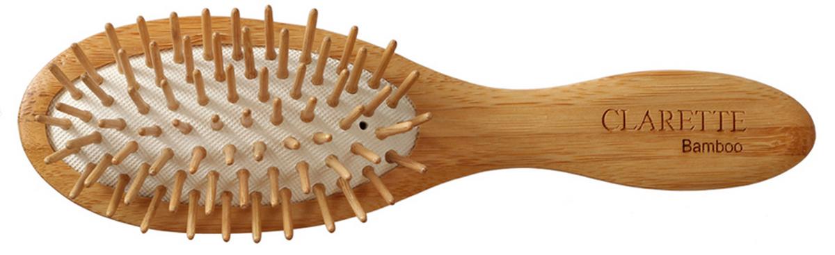 Clarette Щетка для волос на подушке с бамбуковыми зубцами компакт, цвет: рыжийSatin Hair 7 BR730MNКоллекция Сlarette Bamboo-это щетки для волос из натурального бамбукового дерева. Щетки из бамбука более прочные, легкие и долговечные, чем из обычного дерева. На обратной стороне щеток -зареная гравировка с изображением бамбука. Щетка на подушке идеально прочесывает даже густые и длинные волосы. Натуральные бамбуковые зубья бережно ухаживают за волосами, не повреждая их структуры. Подходит для ежедневного применения. Компактный размер щетки делает ее удобной в дороге. Легко помещается в дамской сумочке