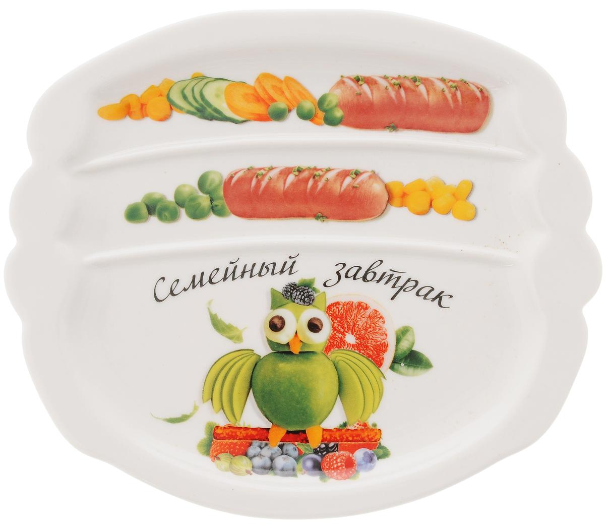 Тарелка для завтрака LarangE Семейный завтрак у колибри, 22,5 х 19 х 1,5 смVT-1520(SR)Тарелка для завтрака LarangE Семейный завтрак у колибри изготовлена из высококачественной керамики. Изделие украшено изображением птицы из еды. Тарелка имеет три отделения: 2 маленьких отделения для сосисок и одно большое отделение для яичницы или другого блюда. Можно использовать в СВЧ печах, духовом шкафу и холодильнике. Не применять абразивные чистящие вещества.Размер тарелки: 22,5 х 19 см. Высота тарелки: 1,5 см.