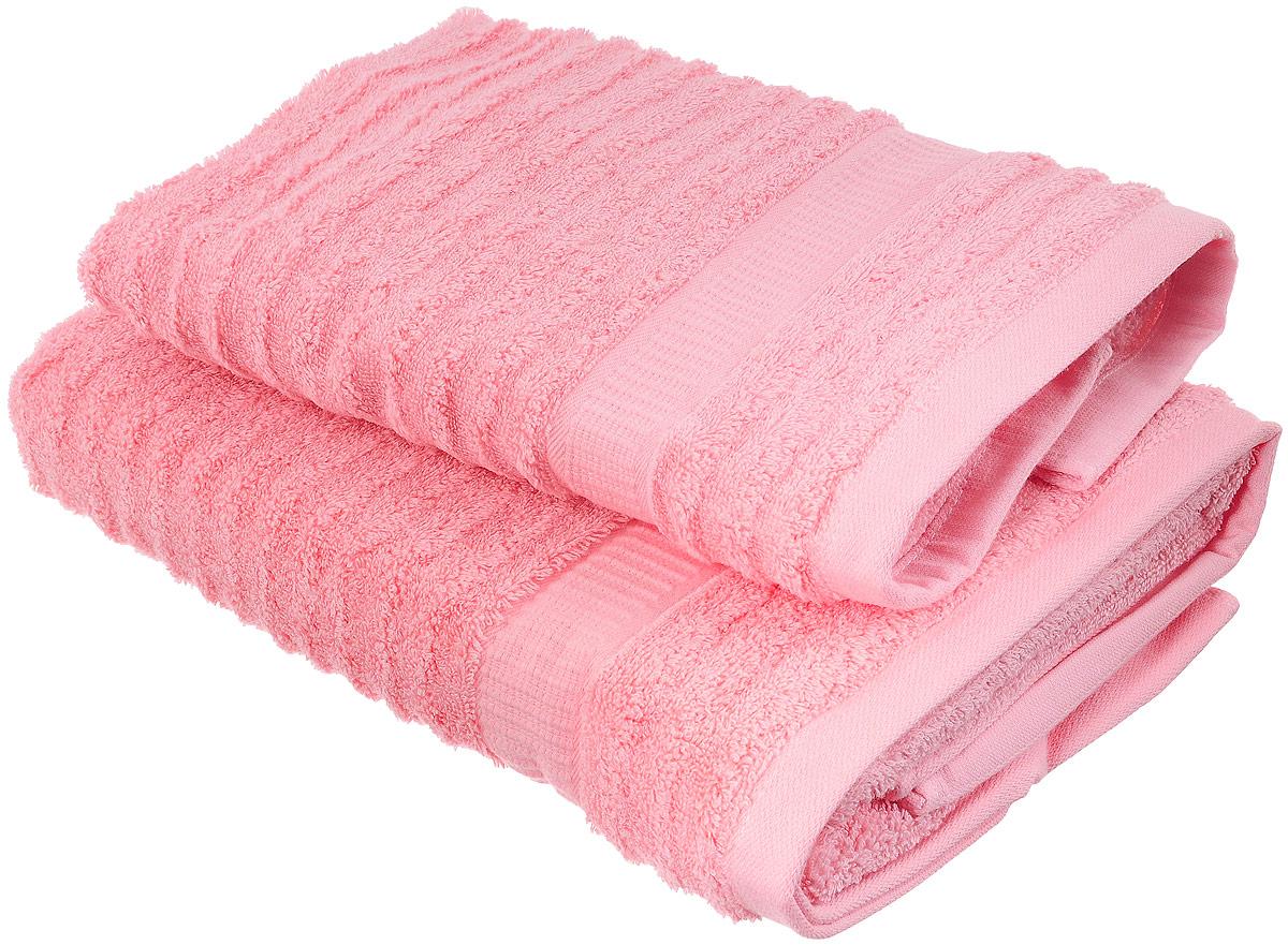 Набор хлопковых полотенец Home Textile, цвет: розовый, 2 шт10503Набор Home Textile состоит из двух полотенец разного размера, выполненных из качественной натуральной махры (100% хлопок). Полотенца имеют ворс различной длины, что создает рельефную текстуру, и классический бордюр. Мягкие и уютные, они прекрасно впитывают влагу и легко стираются. Кроме того, хлопковые полотенца отличаются высокой износоустойчивостью и долгим сроком службы. Такой набор полотенец подарит массу положительных эмоций и приятных ощущений.
