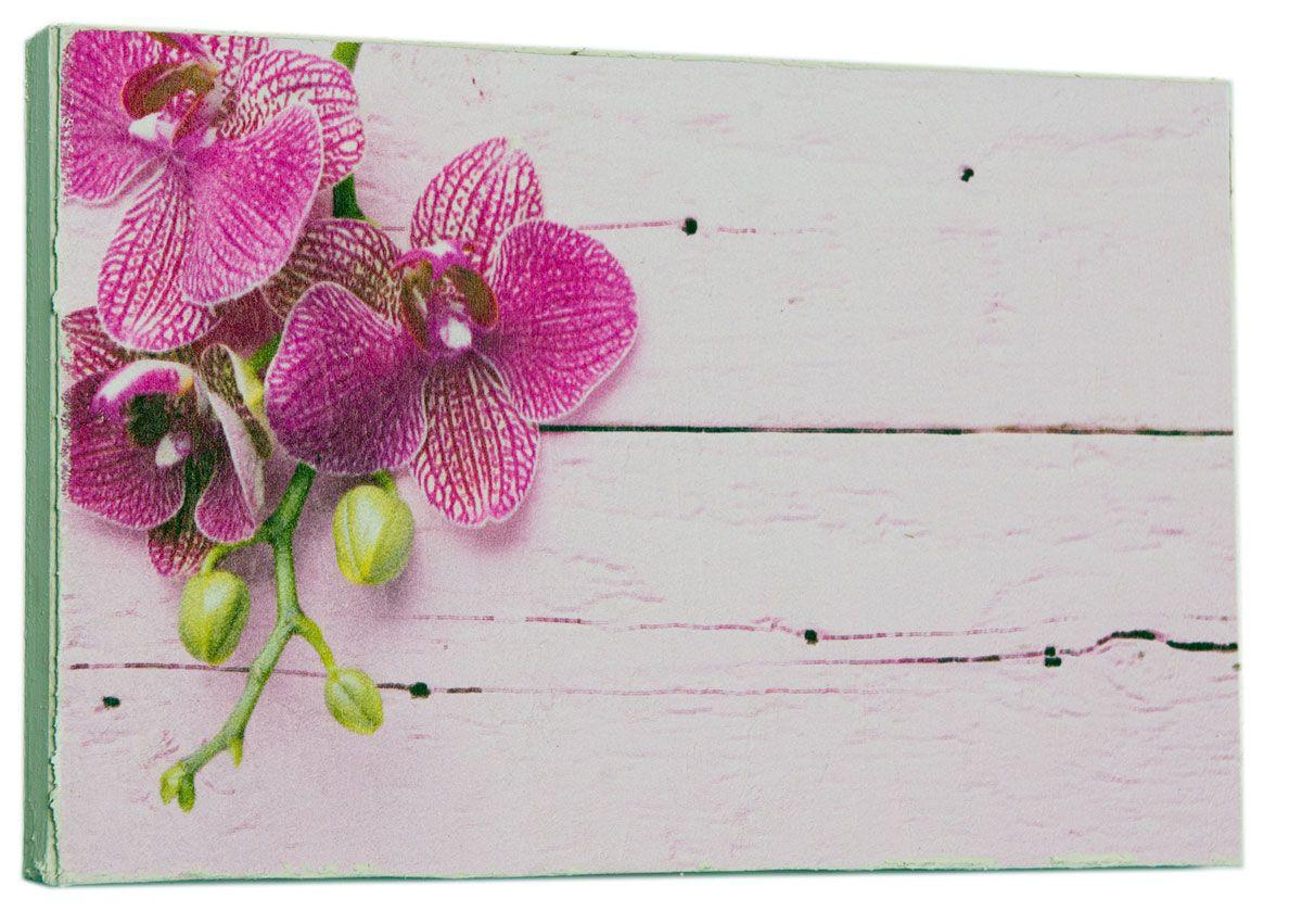 Картина Mister Poster Стильная розовая орхидея, 22 х 14,5 см0406-15-22Картина Mister Poster - это высококачественная репродукция на деревянной раме. Лицевая поверхность имитирует штукатурку или натуральный холст, края окрашены вручную специальным декоративным составом. Современные технологии, уникальное оборудование и оригинальные чернила, используемые при изготовлении, делают постер устойчивым к выцветанию, а также гарантируют стойкость к воздействию негативных внешних факторов. Интерьер дома и офиса, в котором находится человек, в значительной степени влияет на его настроение и работоспособность. Правильное оформление интерьера создает благоприятный психологический климат, улучшает настроение и мотивирует. Добавьте «красок» в ваш интерьер и, возможно, в вашу жизнь.
