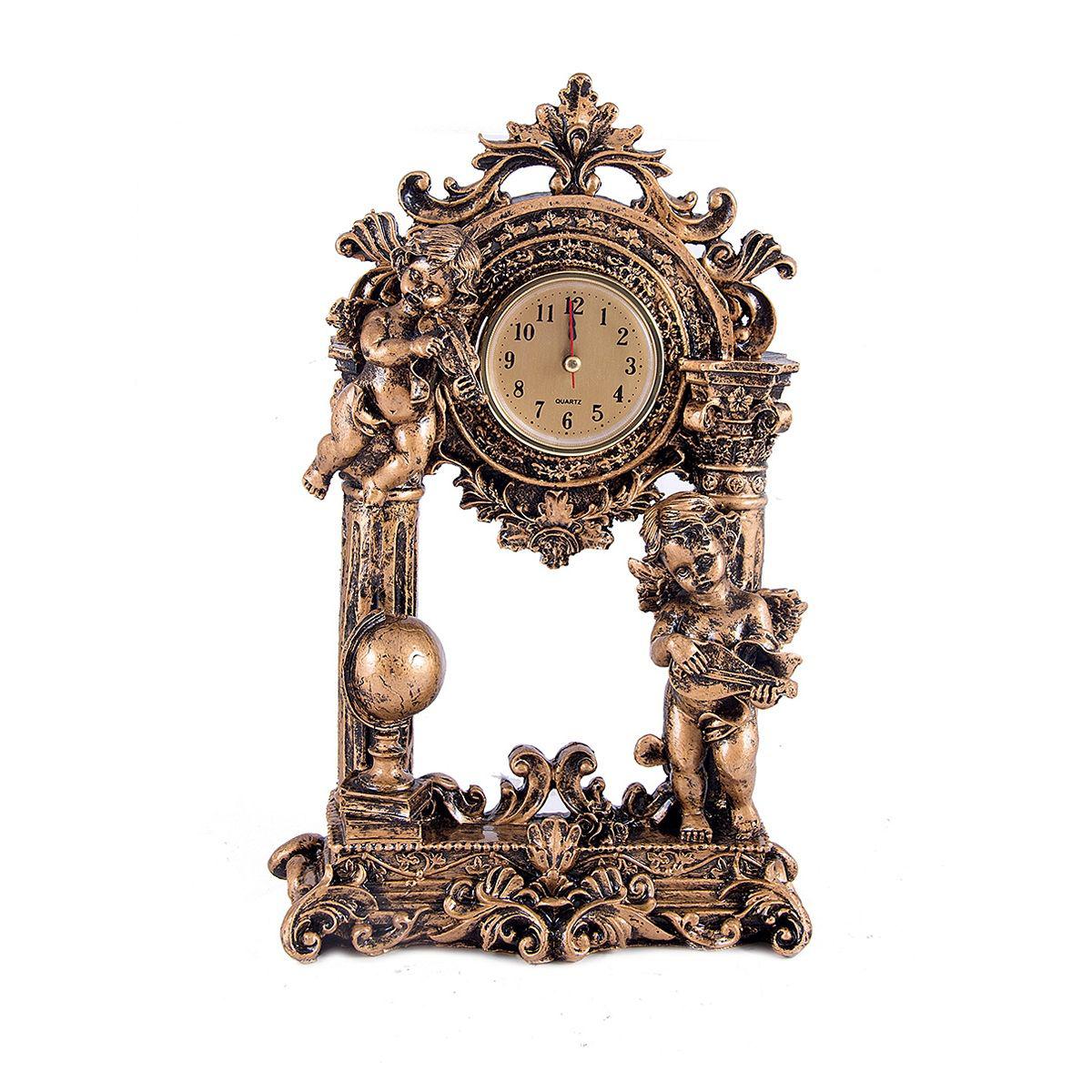 Часы настольные Русские Подарки Ангелочки, 30 х 18 см. 5942159421Настольные кварцевые часы Русские Подарки Ангелочки изготовлены из полистоуна. Часы имеют три стрелки - часовую, минутную и секундную. Изящные часы красиво и оригинально оформят интерьер дома или рабочий стол в офисе. Также часы могут стать уникальным, полезным подарком для родственников, коллег, знакомых и близких. Часы работают от батареек типа АА (в комплект не входят).