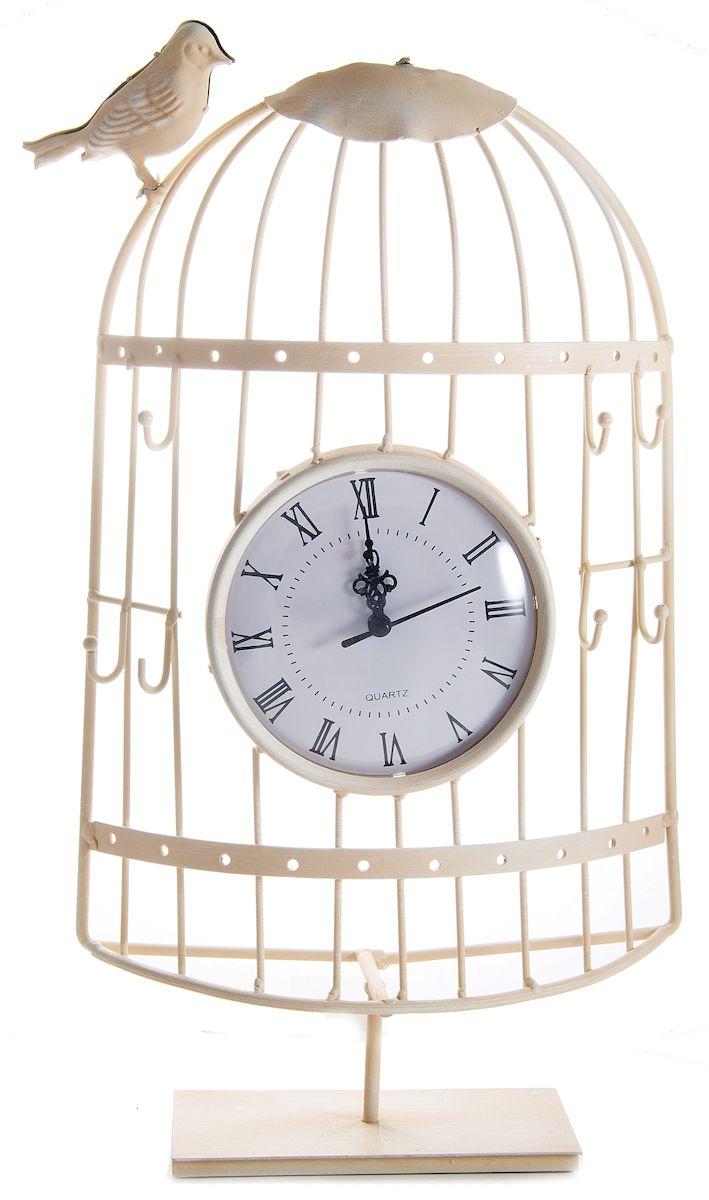 Часы настольные Русские Подарки Очарование прованса, 23 х 10 х 47 см. 6060360603Настольные кварцевые часы Русские Подарки Очарование прованса изготовлены из металла, циферблат защищен стеклом. Корпус оригинально оформлен в виде клетки с птичкой. Часы имеют три стрелки - часовую, минутную и секундную. Такие часы украсят интерьер дома или рабочий стол в офисе. Также часы могут стать уникальным, полезным подарком для родственников, коллег, знакомых и близких. Часы работают от батареек типа АА (в комплект не входят).