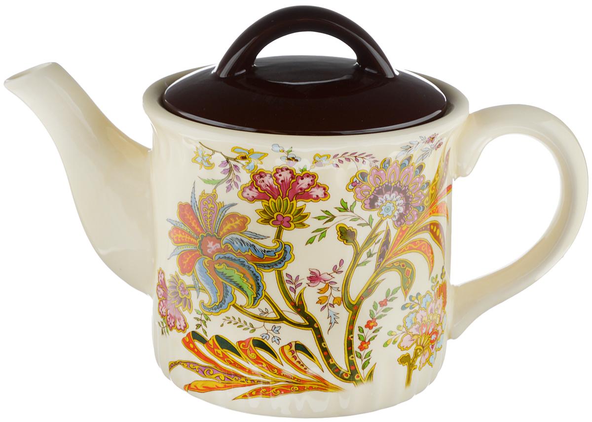 Чайник заварочный Loraine, 850 мл24859Заварочный чайник Loraine изготовлен из высококачественной керамики и оформлен красочным рисунком. Гладкая и идеально ровная поверхность обеспечивает легкую очистку. Чайник поможет заварить крепкий ароматный чай и великолепно украсит стол к чаепитию. Можно использовать в микроволновой печи и мыть в посудомоечной машине. Диаметр чайника (по верхнему краю): 9,5 см. Высота чайника (без учета крышки): 11,5 см. Объем чайника: 850 мл.
