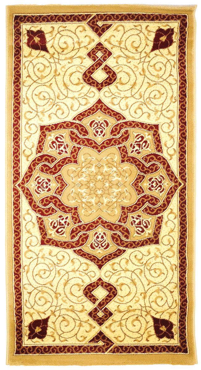 Ковер Kamalak Tekstil, прямоугольный, 80 x 150 см. УК-0087УК-0087Ковер Kamalak Tekstil изготовлен из прочного синтетического материала heat-set, улучшенного варианта полипропилена (эта нить получается в результате его дополнительной обработки). Полипропилен износостоек, нетоксичен, не впитывает влагу, не провоцирует аллергию. Структура волокна в полипропиленовых коврах гладкая, поэтому грязь не будет въедаться и скапливаться на ворсе. Практичный и износоустойчивый ворс не истирается и не накапливает статическое электричество. Ковер обладает хорошими показателями теплостойкости и шумоизоляции. Оригинальный рисунок позволит гармонично оформить интерьер комнаты, гостиной или прихожей. За счет невысокого ворса ковер легко чистить. При надлежащем уходе синтетический ковер прослужит долго, не утратив ни яркости узора, ни блеска ворса, ни упругости. Самый простой способ избавить изделие от грязи - пропылесосить его с обеих сторон (лицевой и изнаночной). Влажная уборка с применением шампуней и моющих средств не противопоказана. ...