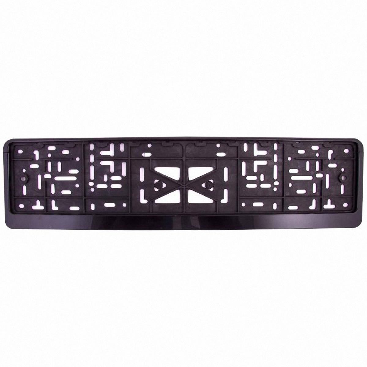 Рамка под номер Skyway, пластмассовая, с защелкой, цвет: черныйS04102003Рамка под номер пластмассовая с защёлкой – предназначена для того, чтобы фиксировать номерной знак на автомобиле, защищая от соприкосновения его с кузовом, а также для защиты от кражи. Рамка имеет надежное крепление с защелкой, изготовлена из морозостойкого пластика. Быстро устанавливается и надолго сохраняет внешний вид. Характеристики: Размер - 13,5*53*1,3см Высота верхнего поля - 5мм Высота нижнего поля - 23мм Материал рамки - пластмасса Крепление – защелка (книжка)