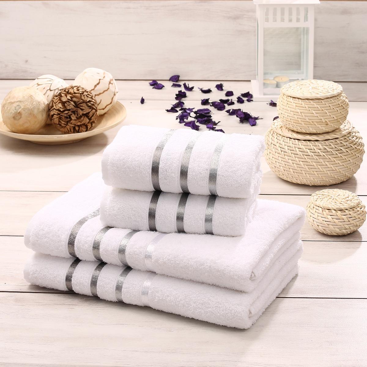 Набор полотенец Karna Bale, цвет: белый, 4 шт531-401Набор Karna Bale включает 2 полотенца для лица, рук и 2 банных полотенца. Изделия выполнены из высококачественного хлопка с отделкой в виде полос. Каждое полотенце отличается нежностью и мягкостью материала, утонченным дизайном и превосходным качеством. Они прекрасно впитывают влагу, быстро сохнут и не теряют своих свойств после многократных стирок. Такой набор создаст в вашей ванной царственное великолепие и подарит чувство ослепительного торжества. А также станет приятным подарком для ваших близких или друзей. Набор украшен текстильной лентой.