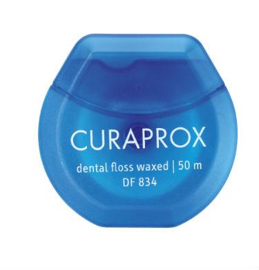 Curaprox DF 834 Нить межзубная мятная, 50 мDF834Вощеная зубная нить очищение межзубных промежутков у пациентов с ароматом мяты. Длина нити 50 м.