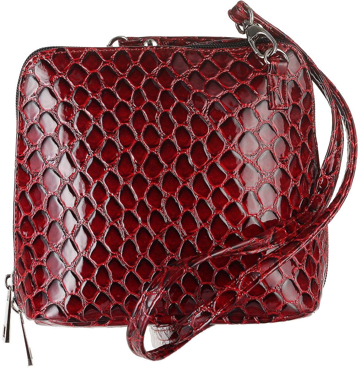 Сумка женская Аntan Крокодил, цвет: красный. 769769Компактная сумка Крокодил фирмы Аntan выполнена из искусственной кожи с фактурным тиснением. Сумка закрывается на застежку-молнию с двумя бегунками. Модель имеет одно отделение, разделенное пополам карманом-средником на застежке-молнии. Внутри расположен накладной карман для мелочей. Снаружи, с тыльной стороны сумки имеется вшитый карман на застежке-молнии. Изделие оснащено удобным наплечным ремнем, который крепится к сумке с помощью металлических карабинов. Сумка Аntan станет ярким и оригинальным подарком для представительниц прекрасного пола, ценящих стиль и качество.