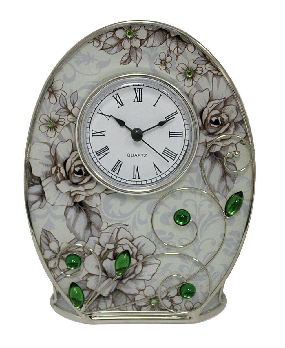 Часы настенные Jardin dEte Благородный изумруд, 12,5 х 16,5 см54 009303Часы Jardin DEte Благородный изумруд станут оригинальным и стильным украшением интерьера офиса, спальни или гостиной. Кроме того, практичный презент из Франции обязательно оценят по достоинству друзья, коллеги и близкие люди.Корпус кварцевых часов изготовлен из стали и стекла, благодаря чему приобрел уникальный дизайн и надёжность. Лицевая сторона декорирована цветочным принтом с зелеными стразами. Циферблат выполнен в чёрно-белых тонах с римскими цифрами. В комплект включена фирменная упаковка.