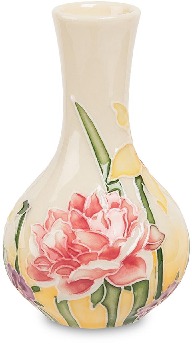 Вазочка Pavone. JP-97/37JP-97/37Ваза высотой 10 см. В эту маленькую красивую вазочку может поместиться только тоненький букетик низкорослых цветов – подснежников, мелких гвоздик, лесных тюльпанов. Вазочка сама по себе украшена бело-розовыми роскошными цветами, как бы вырастающими из ее дна. Поэтому она и сама по себе красиво выглядит, а уж если ее нарисованные цветы получают гармоничное дополнение цветами живыми, получается намного красивее. Вазочка невелика, но даже маленький цветной элемент в интерьере современной гостиной может оживить его, или дополняя классическую мебель с резьбой по дереву, или контрастируя со стилистикой хай-тек и освежая строгие геометрические формы.