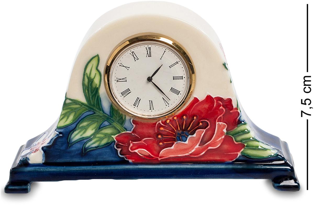 Часы Pavone Цветущий сад. JP-852/13JP-852/13Часы высотой 7.5 см. Компактные часы в очаровательном старинном стиле. Часовой механизм находится внутри фарфорового основания, на котором нарисован цветущий сад. Циферблат имеет классическую круглую форму и выполнен из металла цвета золота. На фарфор нанесены изображения трав и цветов, а их основание окрашено в тёмно-синий цвет. Такие часы прекрасно подойдут для размещения на рабочем столе или на прикроватной тумбочке.