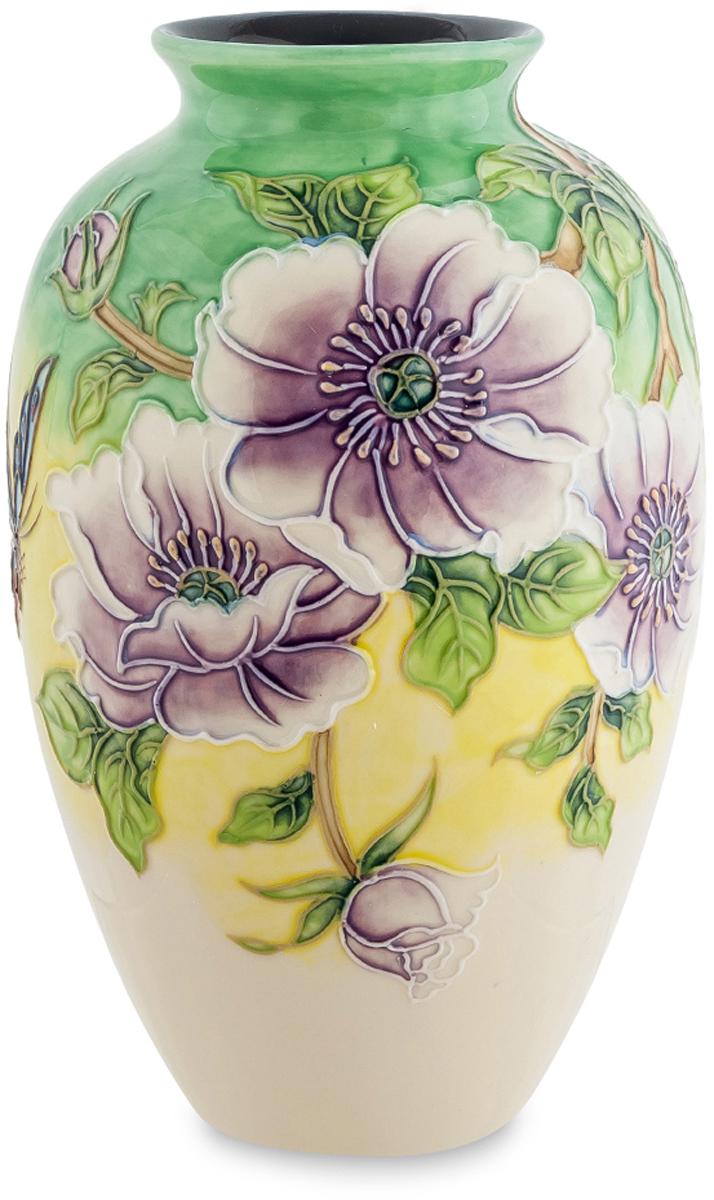 Ваза Pavone Камелия. JP-98/11JP-98/11Роскошная ваза Камелия напоминает древнюю амфору, её внешний вид имеет выпуклые формы, а дизайн содержит крупные сиреневые цветы. Каждый элемент правильно подобран, бутоны умело сочетаются с небольшими листьями, а общий вид рисунка вызывает восторг от ювелирной работы мастера. Фарфоровая ваза такой формы может стать украшением интерьера, либо применяться по своему назначению. Благодаря большому горлышку можно поставить большие букеты цветов, особенно с широкими листьями. Ваза создана дарить весеннее настроение и при дневном свете выглядит особенно красиво. Если вам трудно выбрать подарок к празднику для женщины, то такая ваза будет идеальным вариантом.