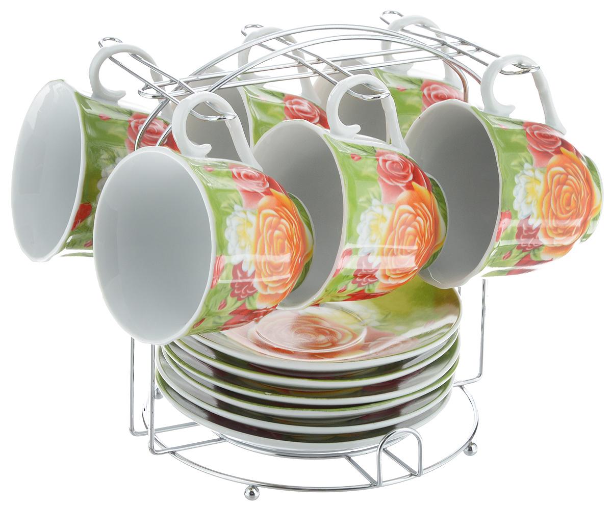 Набор чайный Bella, 13 предметов. DL-F6MS-024115610Набор Bella состоит из 6 чашек и 6 блюдец, изготовленных из высококачественного фарфора. Чашки оформлены красочным рисунком. Изделия расположены на металлической подставке. Такой набор подходит для подачи чая или кофе.Изящный дизайн придется по вкусу и ценителям классики, и тем, кто предпочитает современный стиль. Он настроит на позитивный лад и подарит хорошее настроение с самого утра. Чайный набор Bella - идеальный и необходимый подарок для вашего дома и для ваших друзей в праздники.Объем чашки: 220 мл. Диаметр чашки (по верхнему краю): 8 см. Высота чашки: 7 см. Диаметр блюдца: 14 см. Высота блюдца: 2,3 см.Размер подставки: 17 х 16,5 х 19 см.