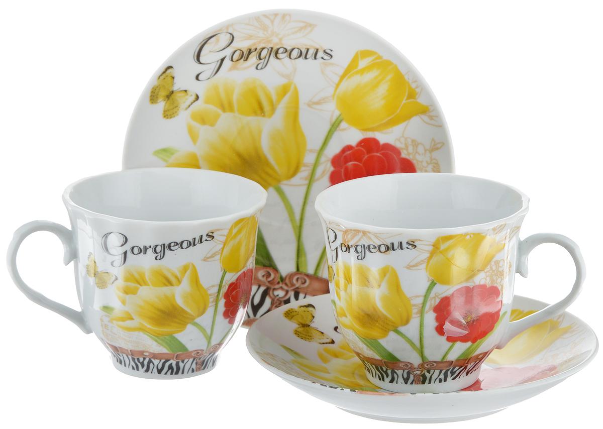 Набор чайный Bella, 4 предмета. DL-F2GB-180115510Чайный набор Bella состоит из 2 чашек и 2 блюдец, изготовленных из высококачественного фарфора. Такой набор прекрасно дополнит сервировку стола к чаепитию, а также станет замечательным подарком для ваших друзей и близких. Объем чашки: 220 мл. Диаметр чашки (по верхнему краю): 8 см. Высота чашки: 7 см. Диаметр блюдца: 14 см.Высота блюдца: 2 см.