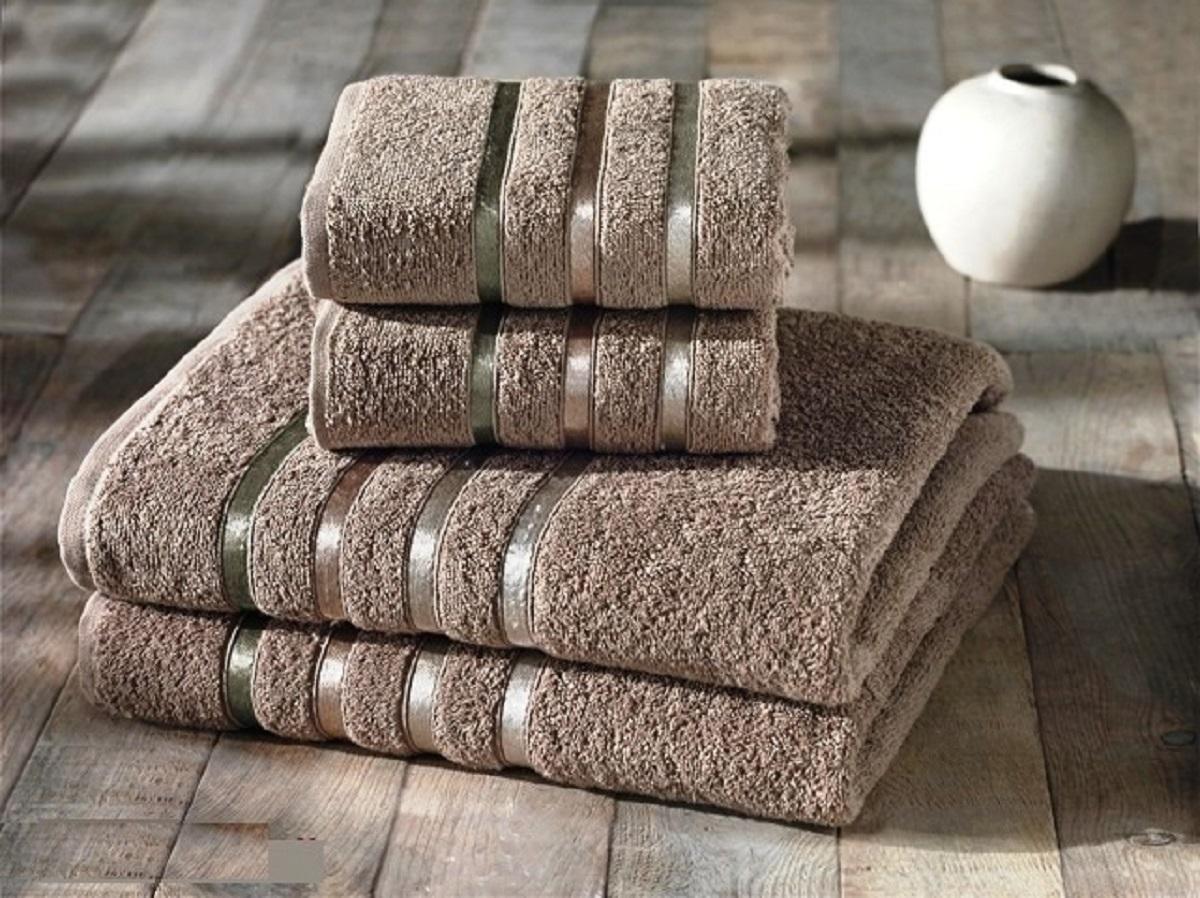 Набор полотенец Karna Bale, цвет: кофейный, 4 шт953/CHAR001Набор Karna Bale включает 2 полотенца для лица, рук и 2 банных полотенца. Изделия выполнены из высококачественного хлопка с отделкой в виде полос. Каждое полотенце отличается нежностью и мягкостью материала, утонченным дизайном и превосходным качеством. Они прекрасно впитывают влагу, быстро сохнут и не теряют своих свойств после многократных стирок. Такой набор создаст в вашей ванной царственное великолепие и подарит чувство ослепительного торжества. А также станет приятным подарком для ваших близких или друзей. Набор украшен текстильной лентой.