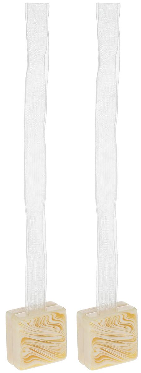 Подхват для штор TexRepublic Ajur. Lenta, на магнитах, цвет: слоновая кость, 2 шт. 7902579025Изящный подхват для штор TexRepublic Ajur. Lenta, выполненный из пластика и текстиля, можно использовать как держатель для штор или для формирования декоративных складок на ткани. С его помощью можно зафиксировать шторы или скрепить их, придать им требуемое положение, сделать симметричные складки. Благодаря магнитам подхват легко надевается и снимается. Подхват для штор является универсальным изделием, которое превосходно подойдет для любых видов штор. Подхваты придадут шторам восхитительный, стильный внешний вид и добавят уют в интерьер помещения. Длина подхвата: 37 см. Количество: 2 шт.