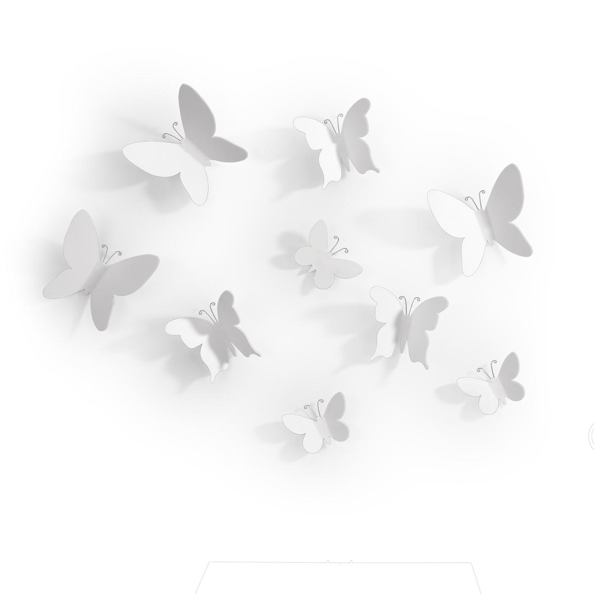 Декоративное украшение Umbra Mariposa, настенное, цвет: белый, 9 шт470130-660Добавьте интерьеру весеннего настроения! Набор из 9 летящих бабочек добавит комнате легкости и превратит любую скучную стену в уникально декорированное пространство. Идеально подойдет для украшения спальни, гостиной или детской комнаты. Крепятся бабочки на специальный двусторонний скотч, который не оставляет следов на стене (идет в комплекте). Три размера: от самой маленькой бабочки 5 х 6 х 1 см до 9 х 10 х 3 см.