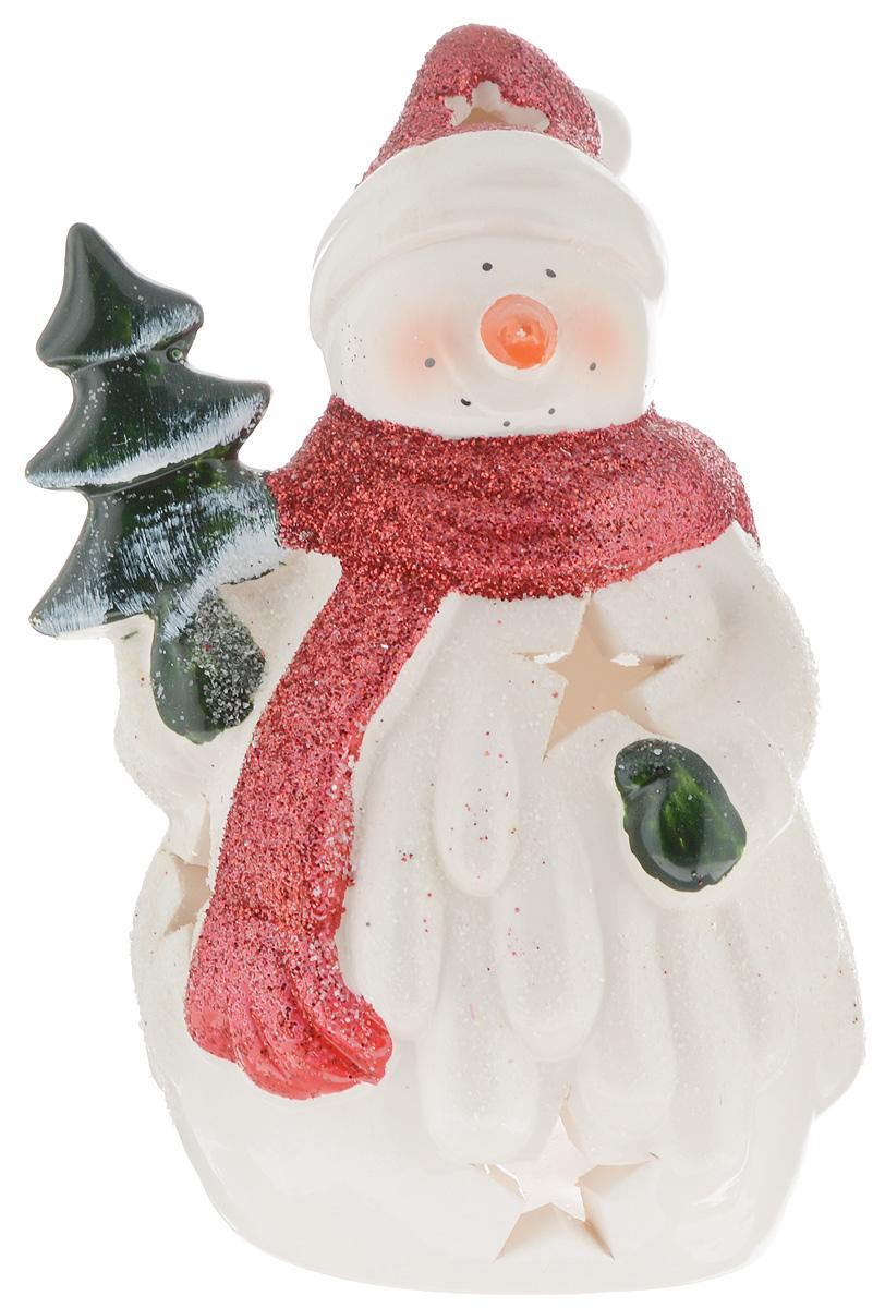 Подсвечник House & Holder, высота 14 смYM082205Подсвечник House & Holder, выполненный из керамики, украсит интерьер вашего дома или офиса. Оригинальный дизайн создаст праздничное настроение. Подсвечник выполнен в виде снеговика и оснащен перфорацией. Вы можете поставить подсвечник в любом месте, где он будет удачно смотреться, и радовать глаз. Кроме того - это отличный вариант подарка для ваших близких и друзей.
