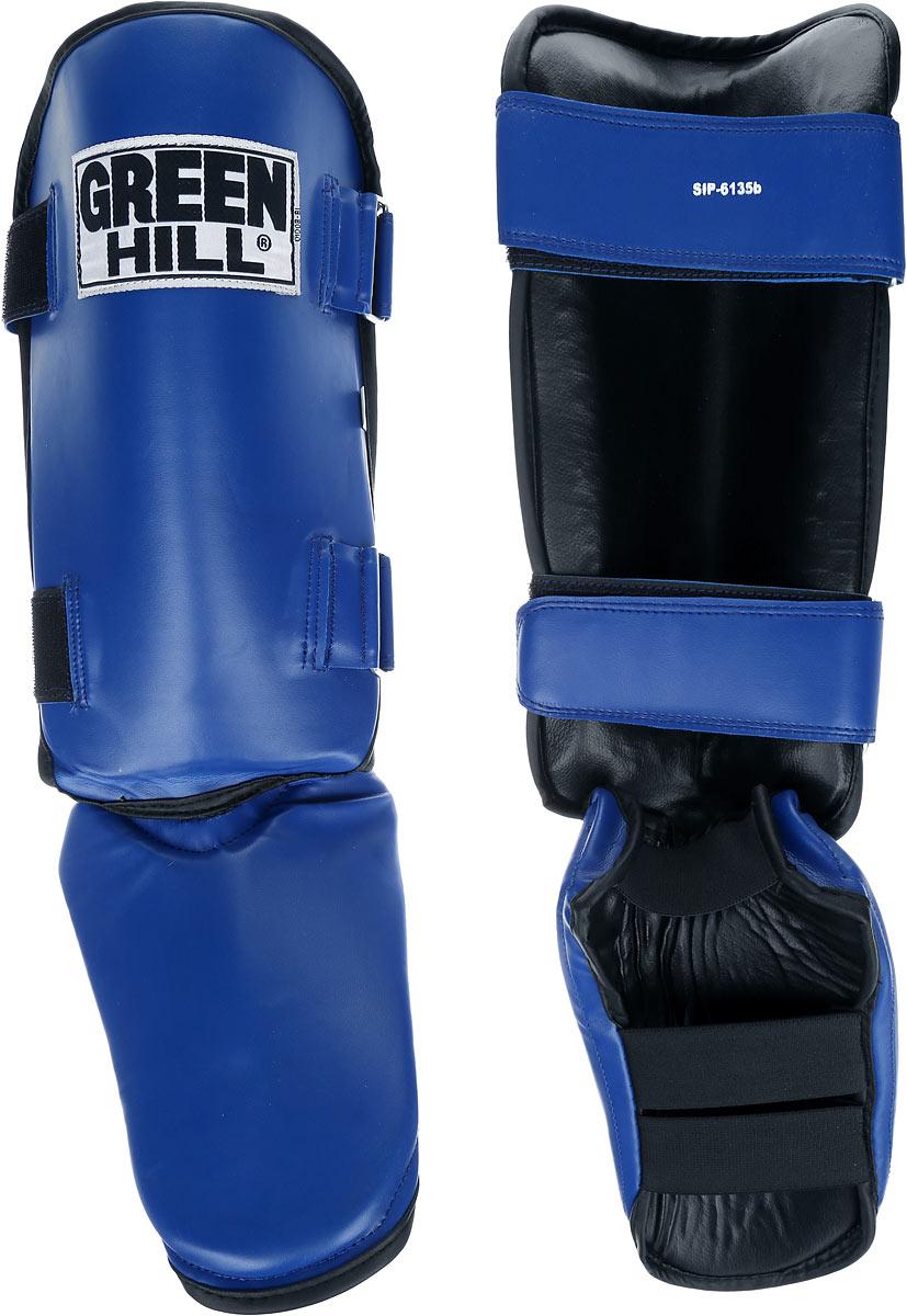 Защита голени и стопы Green Hill, цвет: синий, черный. Размер S. SIPS-6135bSIPS-6135bЗащита голени и стопы Green Hill необходима при занятиях спортом для защиты пальцев и суставов от вывихов, ушибов и прочих повреждений. Выполнена из высококачественной натуральной кожи. Наполнитель изготовлен из вспененного полимера. Защита закрепляется при помощи ремней на липучках. Защита правильно подобранного размера надежно сидит на ноге, не спадает и не сваливается во время поединка. Длина голени: 31 см. Ширина голени: 16 см. Длина стопы: 23 см. Ширина стопы: 16 см.
