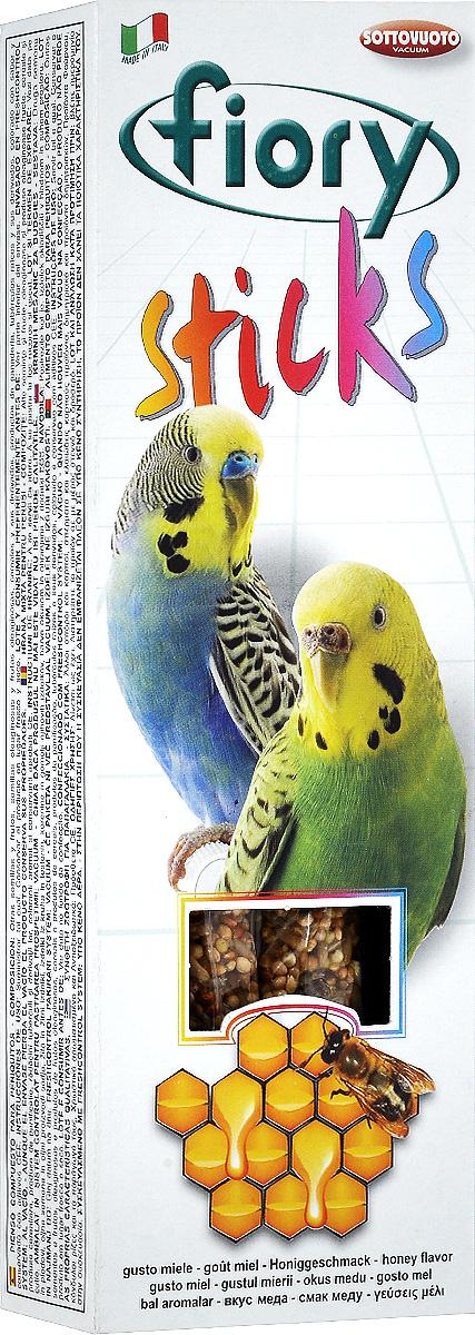 Палочки для попугаев Fiory Sticks, с медом, 2 х 30 г2560Fiory Sticks палочки для попугаев с медом Палочки с девятью различными элементами, среди которых есть семена сафлора, слегка маслянистого по составу (полезен при запорах, а также используется для улучшения пигментации оперения птиц). Клейкий элемент особенно вкусен, позволяет птицам легко его клевать, не раскалывая их на части и не разбрасывая крошки по дну клетки. Поскольку продукт отличается высоким содержанием белка, им не следует злоупотреблять. Как и все подобного рода дополнительное питание, палочки считаются лакомством и являются добавкой к обычному рациону. Палочки удобны для закрепления в клетке, а попугаю удобно склевывать отдельные семечки, не ломая при этом всю палочку. Ингредиенты: зерно, булочные изделия, дрожжи, кукурузные хлопья, натуральные красители и антиоксиданты, одобренные Советом Европы.