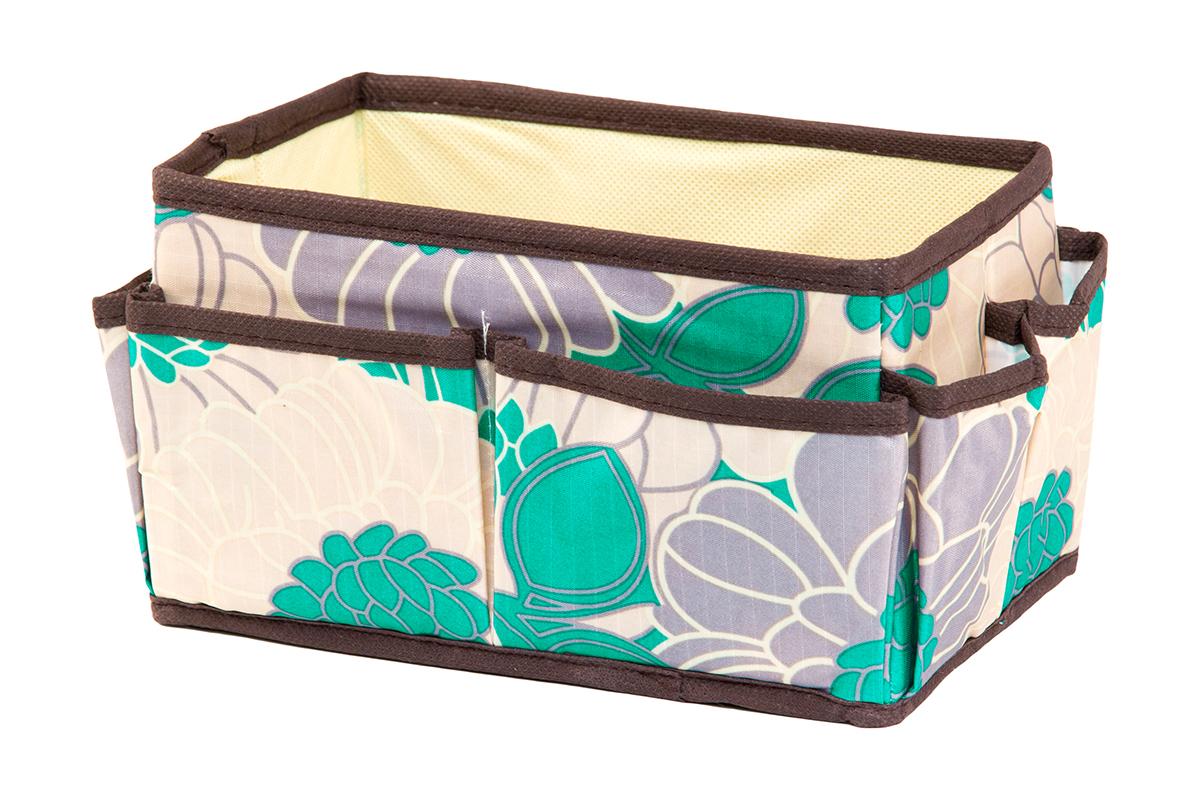 Органайзер для мелочей EL Casa Цветочное поле, 8 карманов, 20 х 12 х 12 см370579Органайзер для мелочей EL Casa Цветочное поле выполнен из качественного полиэстера, декорированного красивым цветочным рисунком. Благодаря специальным вставкам из картона изделие прекрасно держит форму. Удобный и компактный органайзер с 8 карманами с легкостью вместит все необходимые баночки и тюбики. Большое основное отделение можно использовать для кремов, парфюмерии и лаков. Наличие различных кармашков делает возможным хранение декоративной косметики и аксессуаров.