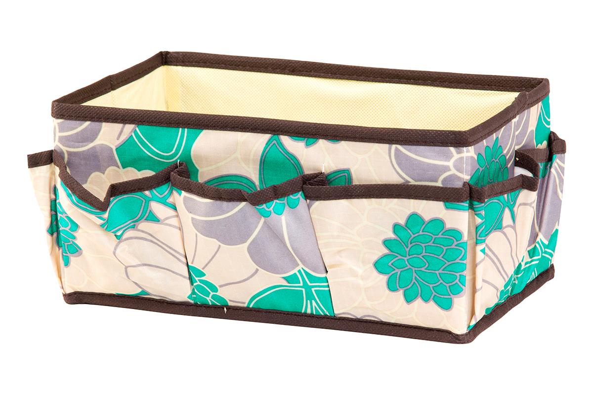 Органайзер для мелочей EL Casa Цветочное поле, 7 карманов, 25 х 15 х 12 см370609Органайзер для мелочей EL Casa Цветочное поле выполнен из качественного полиэстера, декорированного красивым цветочным рисунком. Благодаря специальным вставкам из картона изделие прекрасно держит форму. Удобный и компактный органайзер с 7 карманами с легкостью вместит все необходимые баночки и тюбики. Большое основное отделение можно использовать для кремов, парфюмерии и лаков. Наличие различных кармашков делает возможным хранение декоративной косметики и аксессуаров.