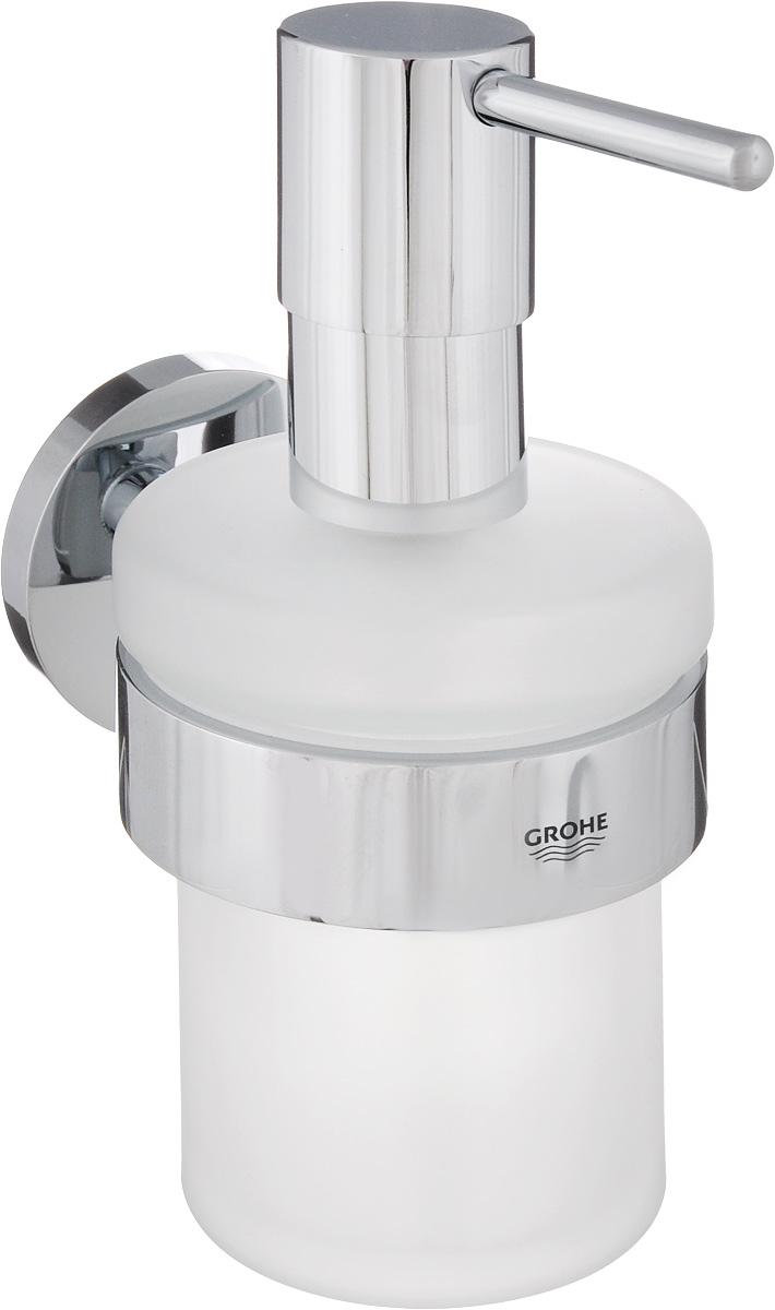 Диспенсер для жидкого мыла Grohe Essentials, с держателем, 200 мл40448001Диспенсер для жидкого мыла Grohe Essentials изготовлен из высококачественного матового стекла. Дозатор выполнен из прочного металла с хромированным покрытием StarLight. Изделие оснащено металлическим держателем, который крепится на стену при помощи саморезов (входят в комплект). Диспенсер очень удобен в использовании, достаточно лишь перелить жидкое мыло в емкость, а когда необходимо использование мыла, легким нажатием выдавить нужное количество. Диспенсер для жидкого мыла Grohe Essentials стильно украсит интерьер, а также добавит в обычную обстановку модный акцент. Размер держателя: 10,5 х 75 х 5,2 см. Размер диспенсера: 7 х 7 х 15,2 см.