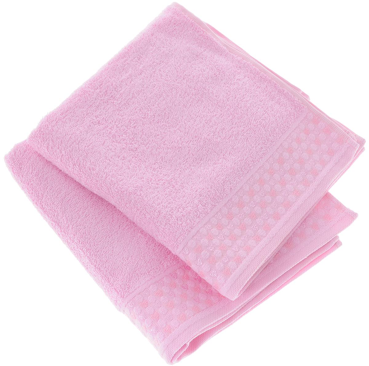 Набор полотенец Tete-a-Tete Сердечки, цвет: розовый, 2 шт. УНП-104-04к68/5/3Набор Tete-a-Tete Сердечки состоит из двух махровых полотенец, выполненных из натурального 100% хлопка. Бордюр полотенец декорирован рисунком сердечек. Изделия мягкие, отлично впитывают влагу, быстро сохнут, сохраняют яркость цвета и не теряют форму даже после многократных стирок. Полотенца Tete-a-Tete Сердечки очень практичны и неприхотливы в уходе. Они легко впишутся в любой интерьер благодаря своей нежной цветовой гамме. Набор упакован в красивую коробку и может послужить отличной идеей подарка.Размеры полотенец: 70 х 140 см, 50 х 90 см.