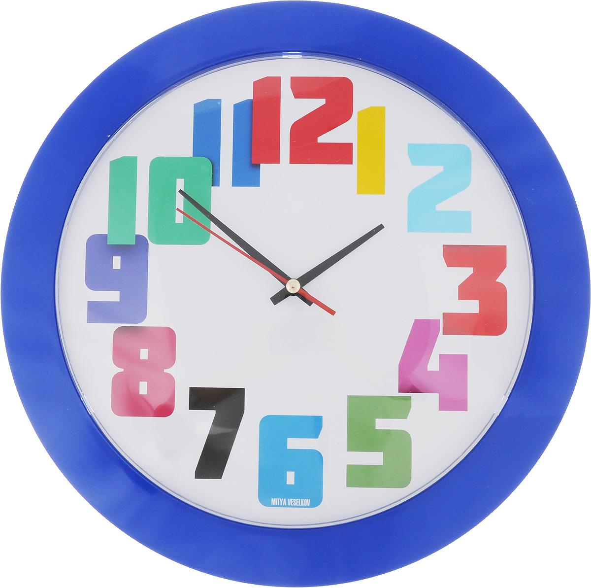 Часы настенные Mitya Veselkov Разноцветные цифры, цвет: синий, диаметр 30 см54 009303Оригинальные настенные часы Mitya Veselkov Разноцветные цифры прекрасно дополнят интерьер комнаты. Круглый корпус часов выполнен из металла синего цвета. Циферблат защищен стеклом. Часы имеют три стрелки - часовую, минутную и секундную.Оформите свой дом таким интерьерным аксессуаром или преподнесите его в качестве презента друзьям, и они оценят ваш оригинальный вкус и неординарность подарка. Диаметр часов: 30 см. Толщина корпуса: 4 см. Часы работают от 1 батарейки типа АА (входит в комплект).