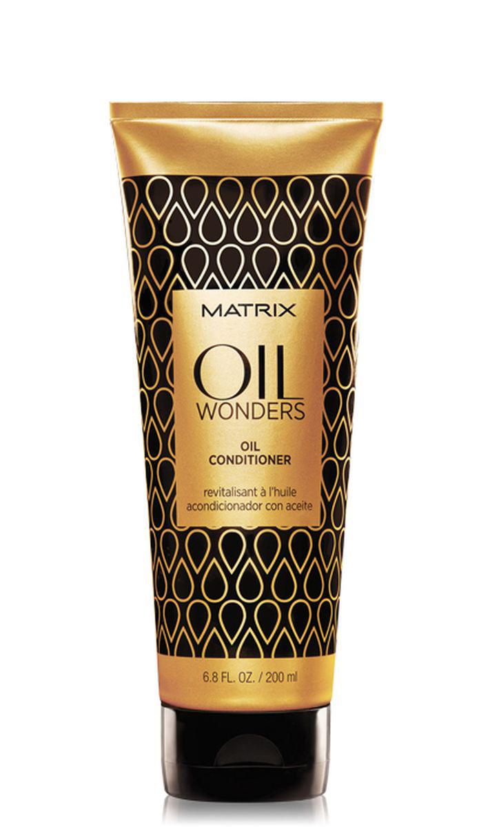 Matrix Oil Wonders Кондиционер с маслом, 200 мл72523WDНевесомый кондиционер Oil Wonders (Ойл Вандерс), обогащенный Марокканским аргановым маслом, возвращает волосам дисциплину, делает их мягкими на ощупь. Придает дополнительное сияние, разглаживая кутикулу волоса, тем самым упрощая процесс укладки.- Невесомое кондиционирование и питание волоса- Подходит для всех типов волос.