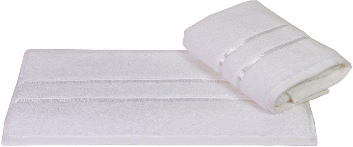 Полотенце Hobby Home Collection Dolce, цвет: белый, 70 х 140 см1501000416Полотенце Hobby Home Collection Dolce выполнено из 100% хлопка. Изделие отлично впитывает влагу, быстро сохнет, сохраняет яркость цвета и не теряет форму даже после многократных стирок. Такое полотенце очень практично и неприхотливо в уходе. А простой, но стильный дизайн полотенца позволит ему вписаться даже в классический интерьер ванной комнаты.