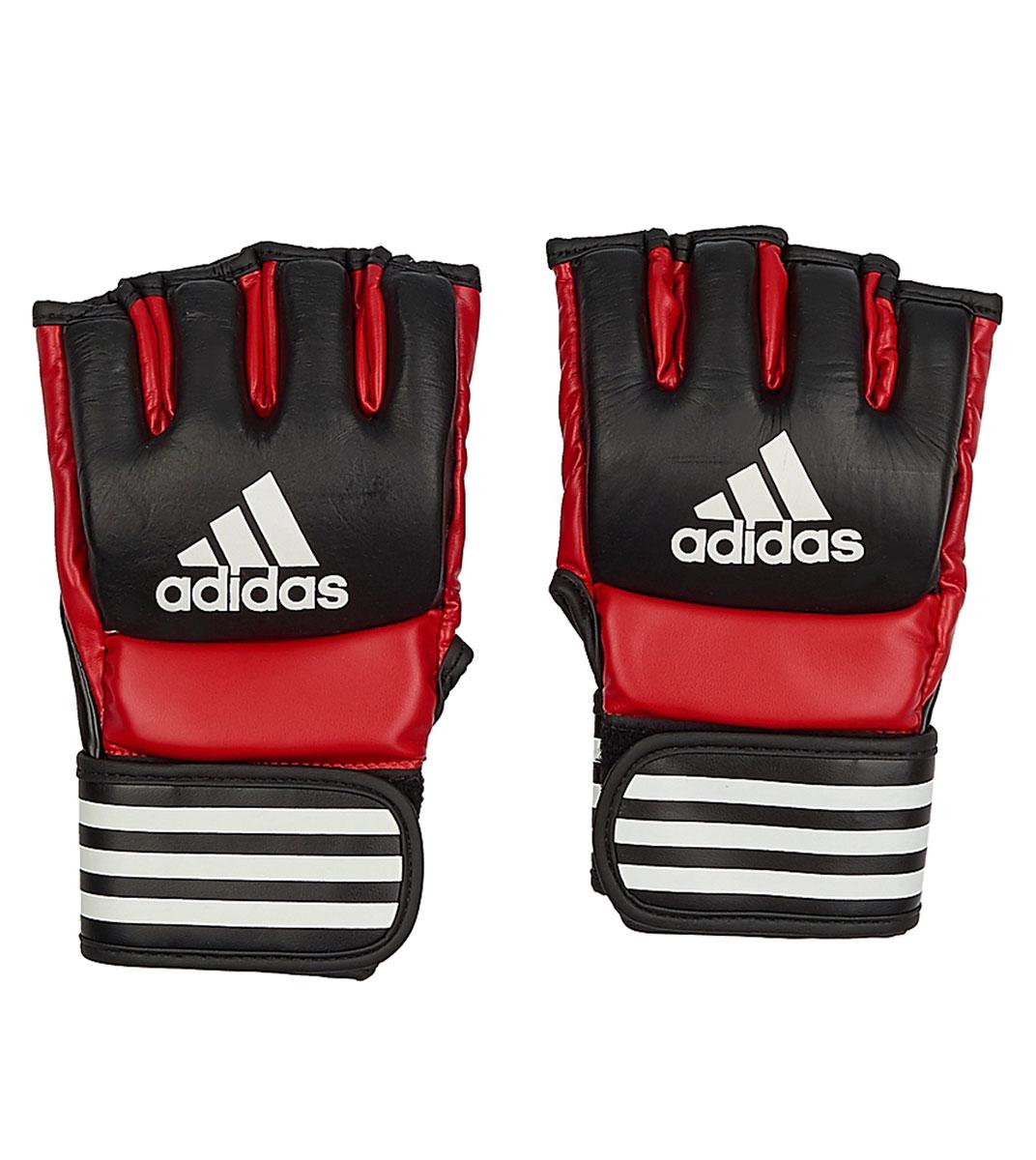 Перчатки для смешанных единоборств Adidas Ultimate Fight, цвет: черный, красный. Размер XLAP02013Боевые перчатки Adidas Ultimate Fight предназначены для занятий смешанными единоборствами. Они изготовлены из натуральной воловьей кожи с черными вставками из вспененного полимера. Внутренняя часть выполнена с использованием технологии I-Comfort+, благодаря чему перчатки быстро высыхают, не скользят по руке и не вызывают аллергии. Застежка на липучке способствует быстрому и удобному одеванию перчаток, плотно фиксирует перчатки на руке. Одобрены UFC.