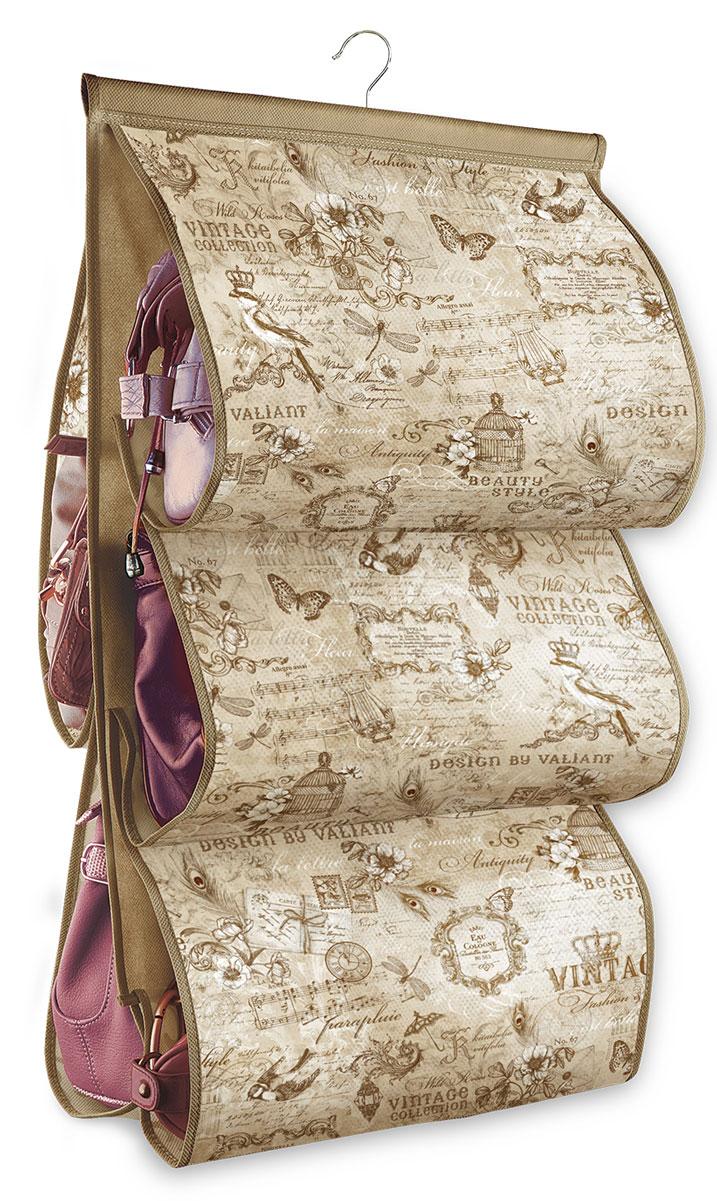 Кофр подвесной для сумок Valiant Vintage, с вешалкой, 5 карманов, 42 x 72 смES-412Подвесной кофр Valiant Vintage, изготовленный из высококачественного нетканого материала с оригинальным принтом, предназначен для хранения сумок. Благодаря специальному крючку, кофр можно повесить в шкафу как обычную вешалку, а эстетичный дизайн гармонично смотрится в любом интерьере. Изделие имеет 5 секций. Подвесной кофр Vintage - это новый взгляд на систему хранения - теперь хранить вещи не только удобно, но и красиво.Размер кофра: 42 х 72 см. Количество секций: 5.