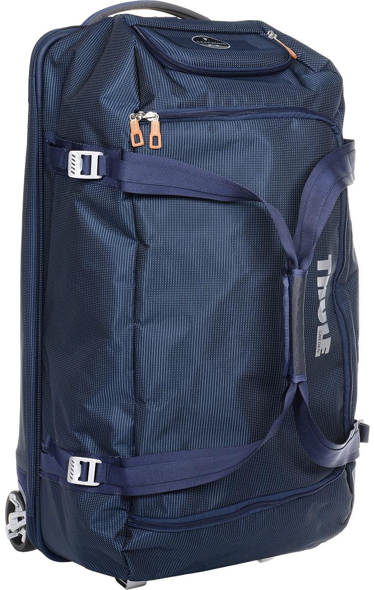 Сумка багажная Thule Crossover Rolling Duffel, на колесах, цвет: темно-синий, 87 лКостюм Охотник-Штурм: куртка, брюкиДорожная сумка на колесах Thule Crossover Rolling Duffel - вместительная сумка с широким входом, куда можно с легкостью положить шлем, ботинки, перчатки, куртку и другие туристические принадлежности.Алюминиевый каркас и водостойкий материал делают эту сумку легкой, но прочной. Надежный экзоскелет и задняя обшивка из полипропилена обеспечат надежную защиту во время путешествий в самых сложных условиях. Крепкие колеса увеличенного размера и телескопическая ручка с технологией Thule V-Tubing гарантирует мягкое, плавное и ровное движение в течение многих лет. Имеются регулировочные ремни для подгонки размера сумки в зависимости от количества багажа. Изготовленное по технологии горячей прессовки ударопрочное отделение SafeZone защитит ваши очки, портативную электронику и другие хрупкие вещи (отделение запирается и может быть удалено для освобождения дополнительного места). Главное отделение с потайным отсеком поможет отделить чистое от грязного, мокрое от сухого и деловое от повседневного.