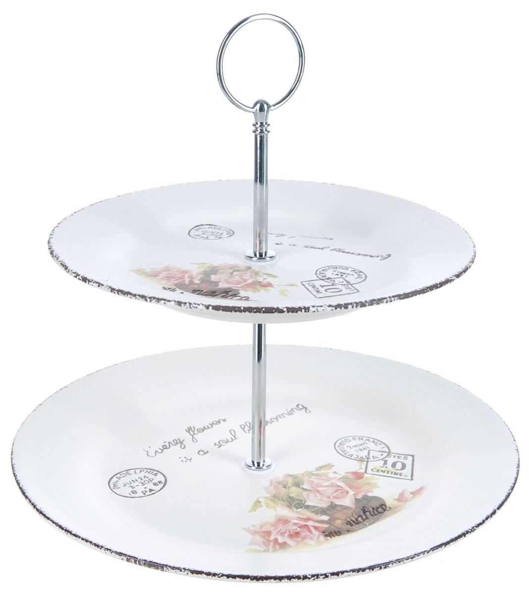 Ваза для фруктов ENS Group Чайная роза, двухъярусная. 1750166CM000001328Двухъярусная ваза ENS Group Чайная роза, выполненная из доломитовой керамики, сочетает в себе изысканный дизайн с максимальной функциональностью. Блюда вазы украшены цветочным рисунком. Изделие предназначено для красивой сервировки фруктов. Такая ваза для фруктов придется по вкусу и ценителям классики, и тем, кто предпочитает утонченность и изящность.Ваза для фруктов украсит сервировку вашего стола и подчеркнет прекрасный вкус хозяина, а также станет отличным подарком.