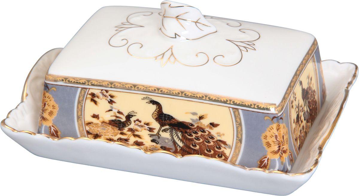 Масленка Elan Gallery Павлин на бежевом180423Великолепная масленка Elan Gallery Павлин на бежевом, выполненная из высококачественной керамики, предназначена для красивой сервировки и хранения масла. Она состоит из подноса и крышки. Масло в ней долго остается свежим, а при хранении в холодильнике не впитывает посторонние запахи. Масленка Elan Gallery Павлин на бежевом идеально подойдет для сервировки стола и станет отличным подарком к любому празднику. Не рекомендуется применять абразивные моющие средства. Не использовать в микроволновой печи. Размер масленки: 16 х 11,5 х 7 см.