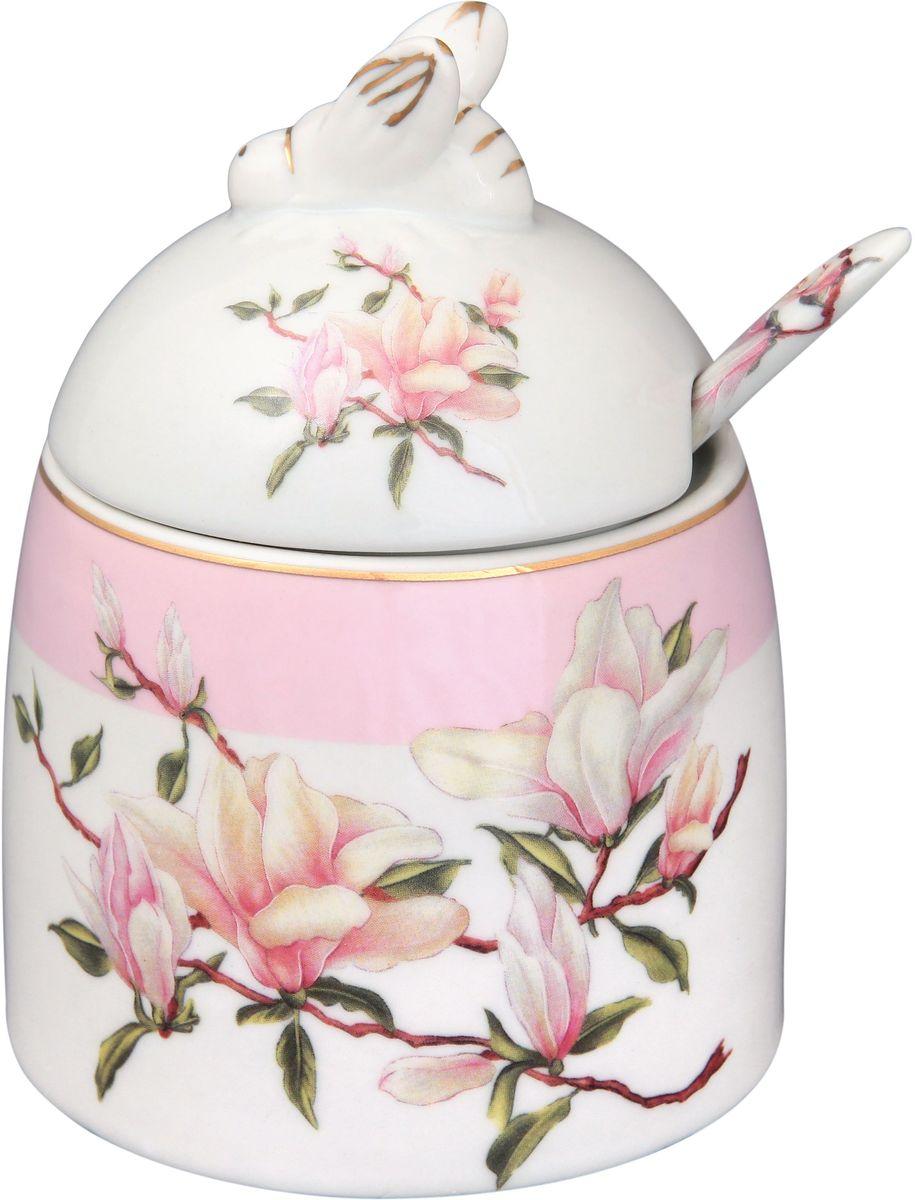 Горшочек для меда Elan Gallery Орхидея, с ложкой, 300 мл180441Горшочек для меда - удобный предмет для хранения любимого лакомства в оригинальном исполнении. Дополнит облик вашей кухни и прекрасно впишется в интерьер. Станет отличным подарком для любой хозяйки. Данная модель будет замечательной покупкой или подарком другу. Эта емкость марки Elan Gallery превосходно подойдет под ваш имидж и преподнесет вас в хорошем свете и на светских раутах и на отдыхе. Размер горшочка: 11,5 х 9 см. Объем горшочка: 300 мл.