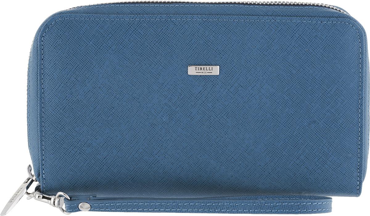 Портмоне Tirelli, цвет: синий. 15-321-02INT-06501Женское портмоне Tirelli - это не только удобная и практичная вещь, но и стильный современный аксессуар, который, благодаря своему привлекательному дизайну и высокому качеству исполнения, блестяще подчеркнет тонкий взыскательный вкус своей обладательницы.Выполнено из натуральной кожи и декорировано оригинальным тиснением. Модель закрывается на молнию. Внутри четыре отделения под купюры, двенадцать кармашков под кредитные карты или визитки и два скрытых кармана. Отделение для мелочи находится внутри и закрывается на металлическую молнию.Для удобного ношения кошелька в руке сбоку на небольшой карабин прикрепляется ремешок.Портмоне упаковано в фирменную коробку.