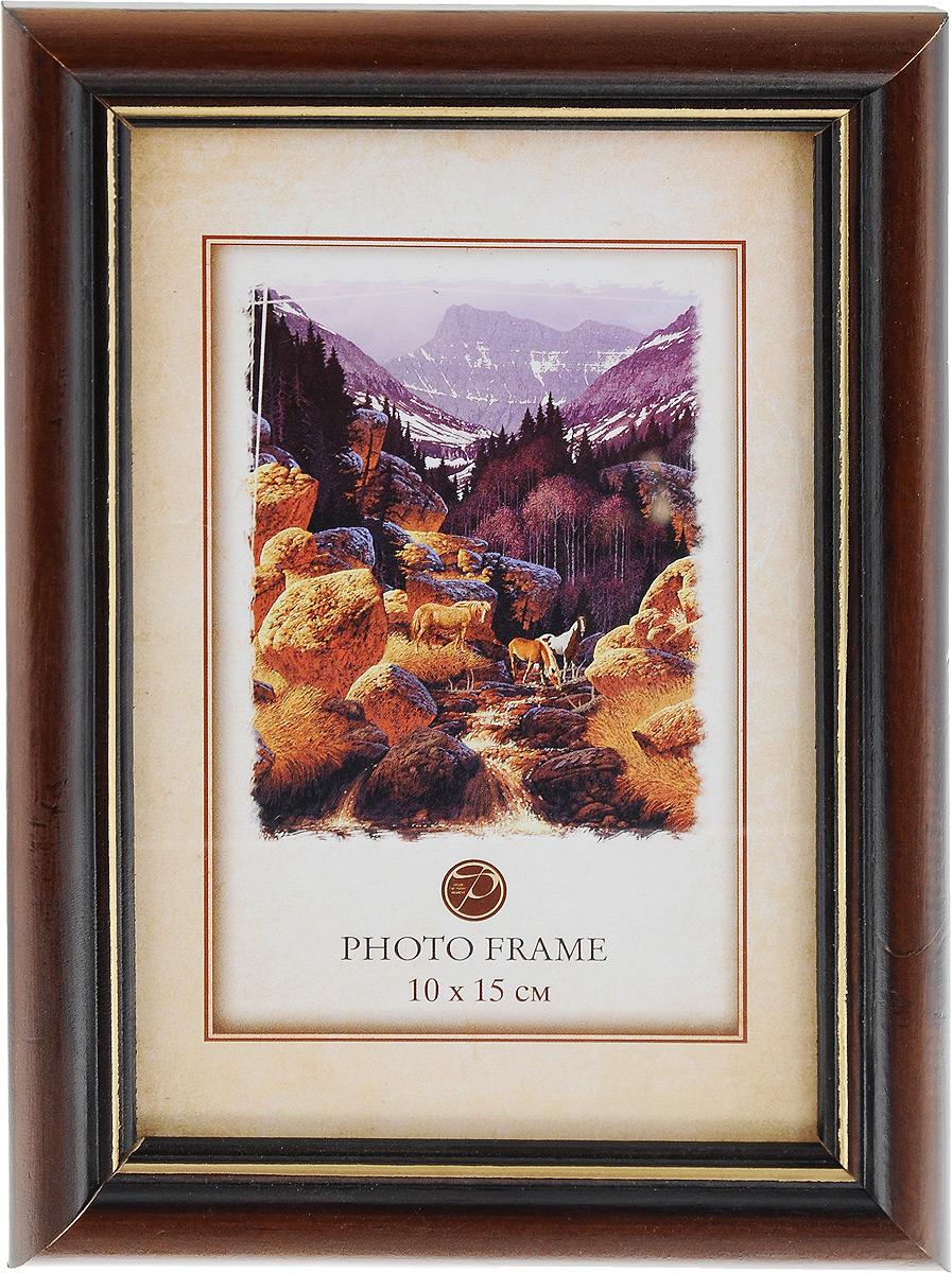 Фоторамка Pioneer Carol, цвет: темно-коричневый, 10 x 15 см7686 156V_темно-коричневыйФоторамка Pioneer Carol выполнена в классическом стиле из натурального дерева и стекла, защищающего фотографию. Оборотная сторона рамки оснащена специальной ножкой, благодаря которой ее можно поставить на стол или любое другое место в доме или офисе. Такая фоторамка поможет вам оригинально и стильно дополнить интерьер помещения, а также позволит сохранить память о дорогих вам людях и интересных событиях вашей жизни.