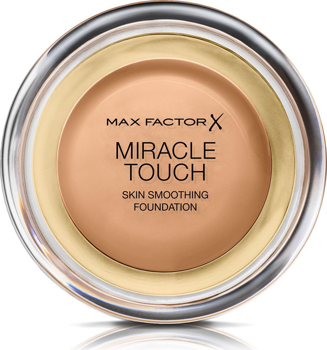 Max Factor Тональная Основа Miracle Touch Тон 80 bronze 11,5 гр002722Уникальная универсальная тональная основа MaxFactorMiracleTouch обладает кремообразной формулой, благодаря которой превосходно подготовить кожу для макияжа очень легко. Всего один слой без необходимости нанесения консилера или пудры. Легкая твердая тональная основа тает в руках и гладко наносится на кожу, создавая идеальное, безупречно блестящее и равномерное покрытие, не слишком прозрачное и не слишком плотное. В результате кожа выглядит свежей, необычайно ровной и приобретает сияние. Чтобы создать безупречное покрытие, можно нанести всего один легкий слой тональной основы или же сделать покрытие более плотным благодаря специальной формуле. Тональная основа подходит для всех типов кожи, включая чувствительную кожу, и не вызывает угревой сыпи, так как не закупоривает поры. Спонж в комплекте для простого и аккуратного нанесения где угодно.Идеальное покрытие в один слой- консилер и пудра не нужны. Умеренное или плотное покрытие благодаря специальной формуле. Не вызывает угревую сыпь и не закупоривает поры. Дерматологически протестировано, подходит для чувствительной кожи.Удобная компактная форма, которую легко держать в руках, со спонжем для быстрого и простого нанесения. Идеальный оттенок должен соответствовать тону кожи на линии подбородка. Для получения наиболее профессионального результата с помощью спонжа, входящего в комплект, нанеси тональную основу MiracleTouchLiquidIllusion и распредели ее от центра лица к краям. Чтобы скрыть темные круги и недостатки кожи, наноси основу краем спонжа. Всегда наноси продукт при ярком дневном освещении.