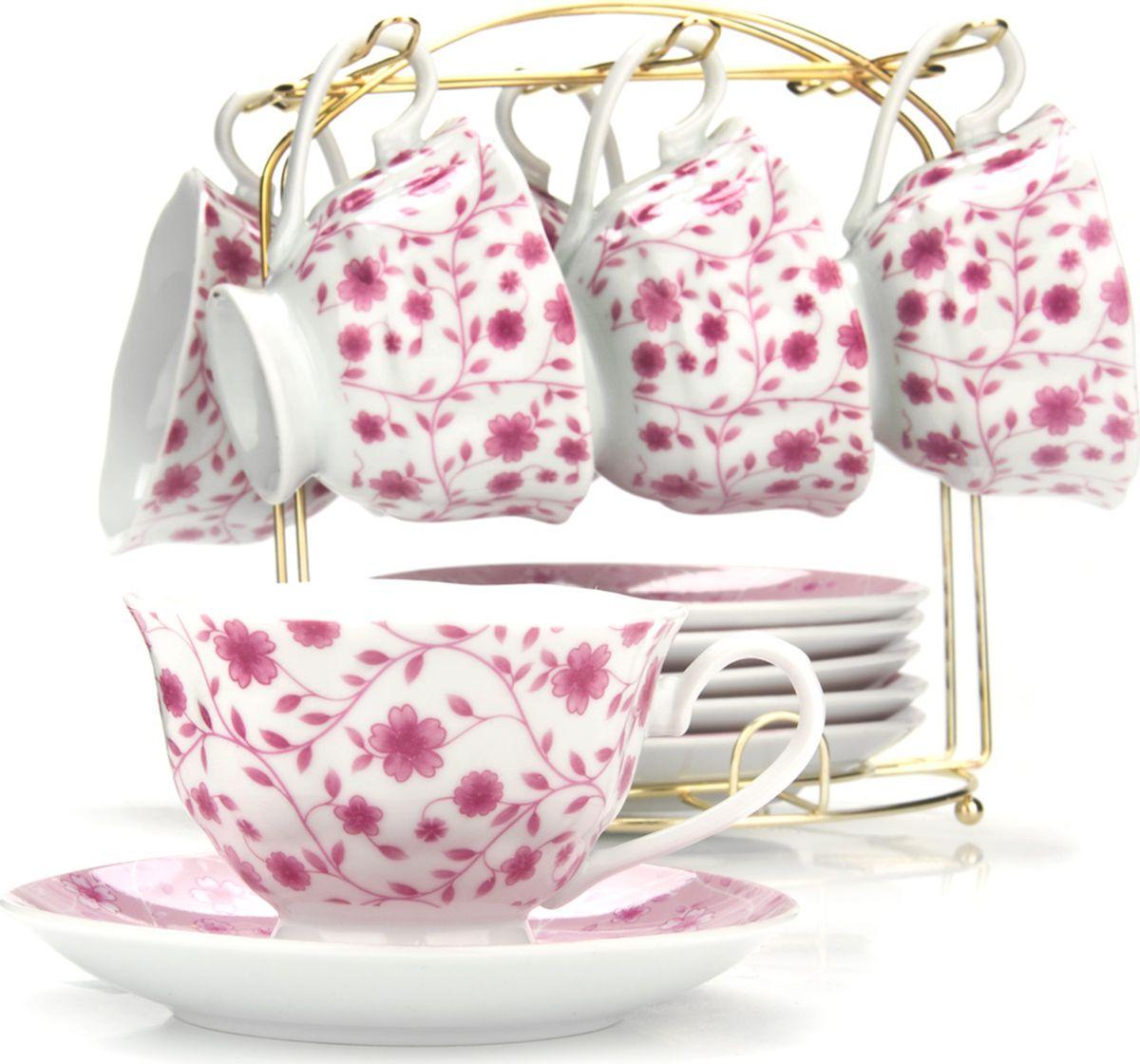 Сервиз чайный Loraine, на подставке, 13 предметов. 43297115610Чайный набор состоит из шести чашек, шести блюдец и металлической подставки золотого цвета. Предметы набора изготовлены из качественного фарфора и оформлены красочным цветным рисунком. Чайный набор идеально подойдет для сервировки стола и станет отличным подарком к любому празднику. Все изделия можно компактно хранить на подставке, входящей в набор. Подходит для мытья в посудомоечной машине.Диаметр чашки: 9,5 см.Высота чашки: 6,5 см.Объем чашки: 180 мл.Диаметр блюдца: 14 см.