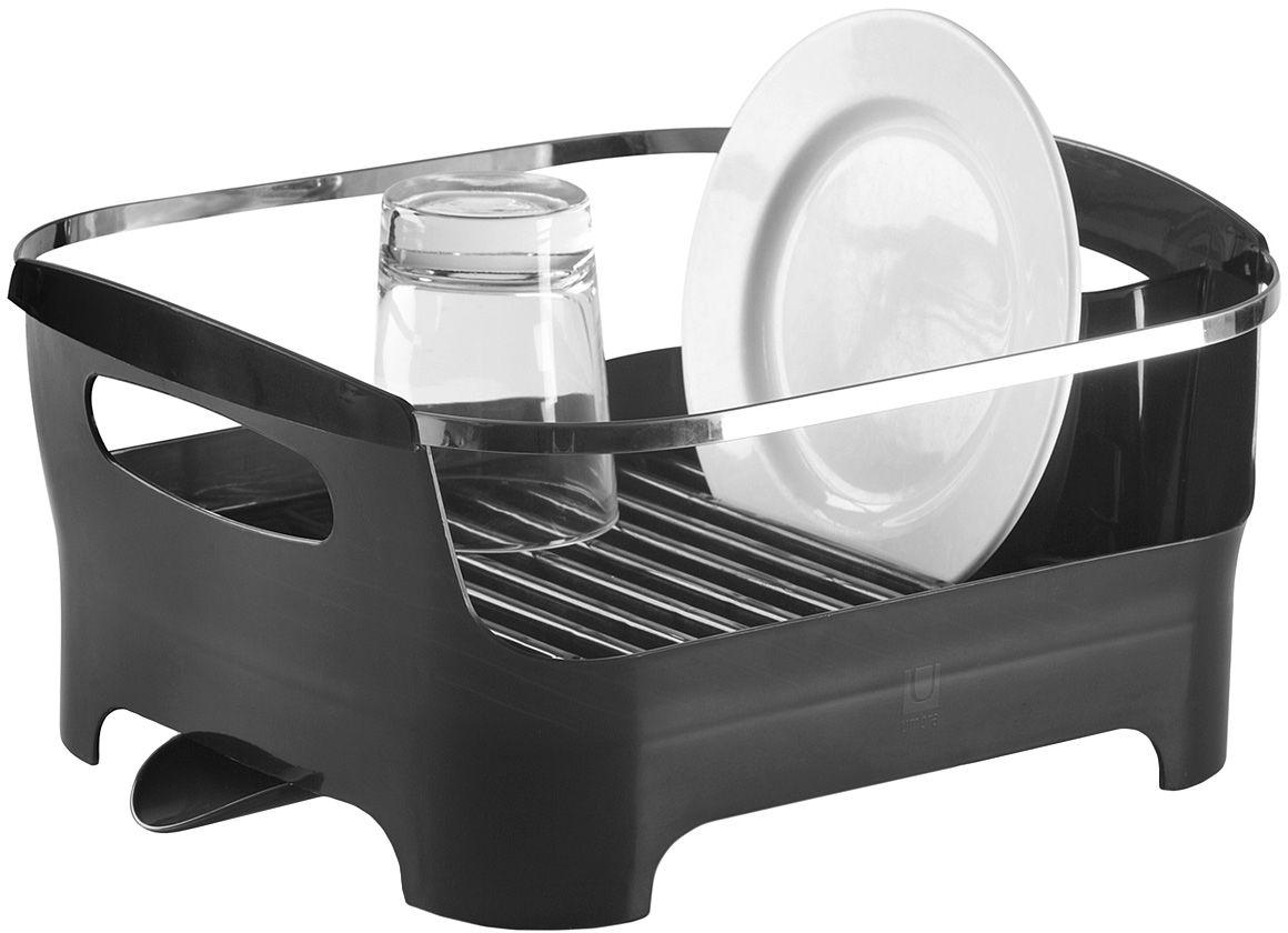 Сушилка для посуды Umbra Basin, цвет: серый330591-582Современный дизайн создается ради удобства и функциональности, поэтому гениальная сушилка Basin отличается от всех своих предшественников времен наших бабушек и дедушек. Пространство для посуды отделено от внешнего мира бортиком: в нем есть удобные ручки для переноски, а главное, тарелки случайно не выпадут и не разобьются. Вода со свежевымотой посуды через желобки для тарелок стекает вниз, в специальное отделение, где собирается и выводится через носик на боку сушилки. Вы можете поставить ее в раковину или на рабочую поверхность рядом. Изготовлена из высококачественного пластика без содержания вредного бисфенола.