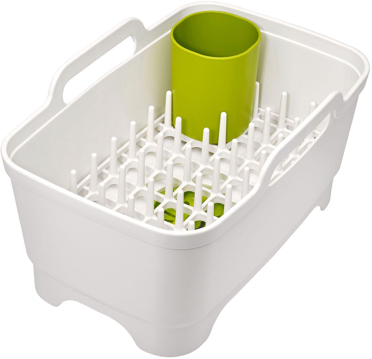 Набор для мойки и сушки посуды Joseph Joseph, цвет: белыйVT-1520(SR)Набор для мойки и сушки посуды Joseph Joseph включает в себя тазик для мытья, со встроенной пробкой для слива/удержания воды и съемную сушилку для посуды и столовых приборов. Компактный и функциональный дизайн, который поможет по максимуму использовать существующее пространство: подставка для посуды может использоваться как внутри таза, так и на рабочей поверхности. Сам тазик оснащен удобными широкими ручками для переноски, его размеры идеально впишутся в любую раковину.Моется вручную.