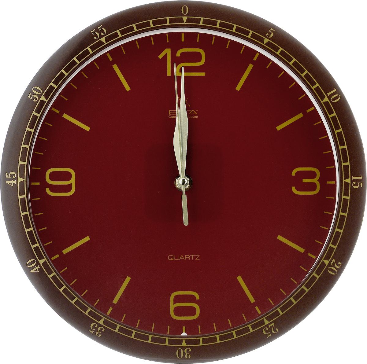 Часы настенные Вега Классика, цвет: коричневый, бордовый, золотой, диаметр 28,5 смП1-9815/7-64Настенные кварцевые часы Вега Классика, изготовленные из пластика, прекрасно впишутся в интерьер вашего дома. Круглые часы имеют три стрелки: часовую, минутную и секундную, циферблат защищен прозрачным стеклом. Часы работают от 1 батарейки типа АА напряжением 1,5 В (не входит в комплект). Диаметр часов: 28,5 см.