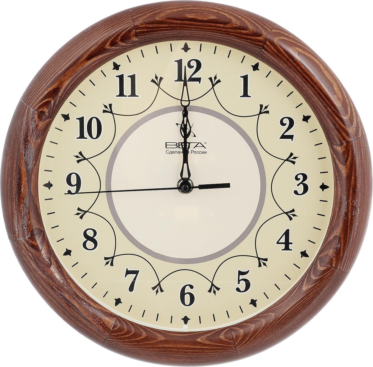 Часы настенные Вега Классика, диаметр 30 см. Д1КД/7Д1КД/7-12Настенные кварцевые часы Вега Классика, изготовленные из дерева, прекрасно впишутся в интерьер вашего дома. Часы имеют три стрелки: часовую, минутную и секундную, циферблат защищен прозрачным стеклом. Часы работают от 1 батарейки типа АА напряжением 1,5 В (не входит в комплект). Диаметр часов: 30 см.
