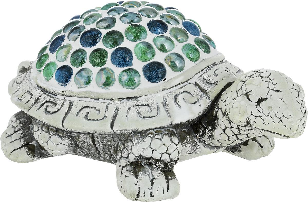 Фигурка декоративная Лилло Черепаха, цвет: серый, зеленый, голубой, длина 24 смFLY01161Декоративная фигурка Черепаха станет необычным аксессуаром для вашего интерьера и создаст незабываемую атмосферу. Фигурка изготовлена из керамики в виде черепахи. Эта очаровательная вещь послужит отличным подарком близкому человеку, родственнику или другу, а также подарит приятные мгновения и окунет вас в лучшие воспоминания.