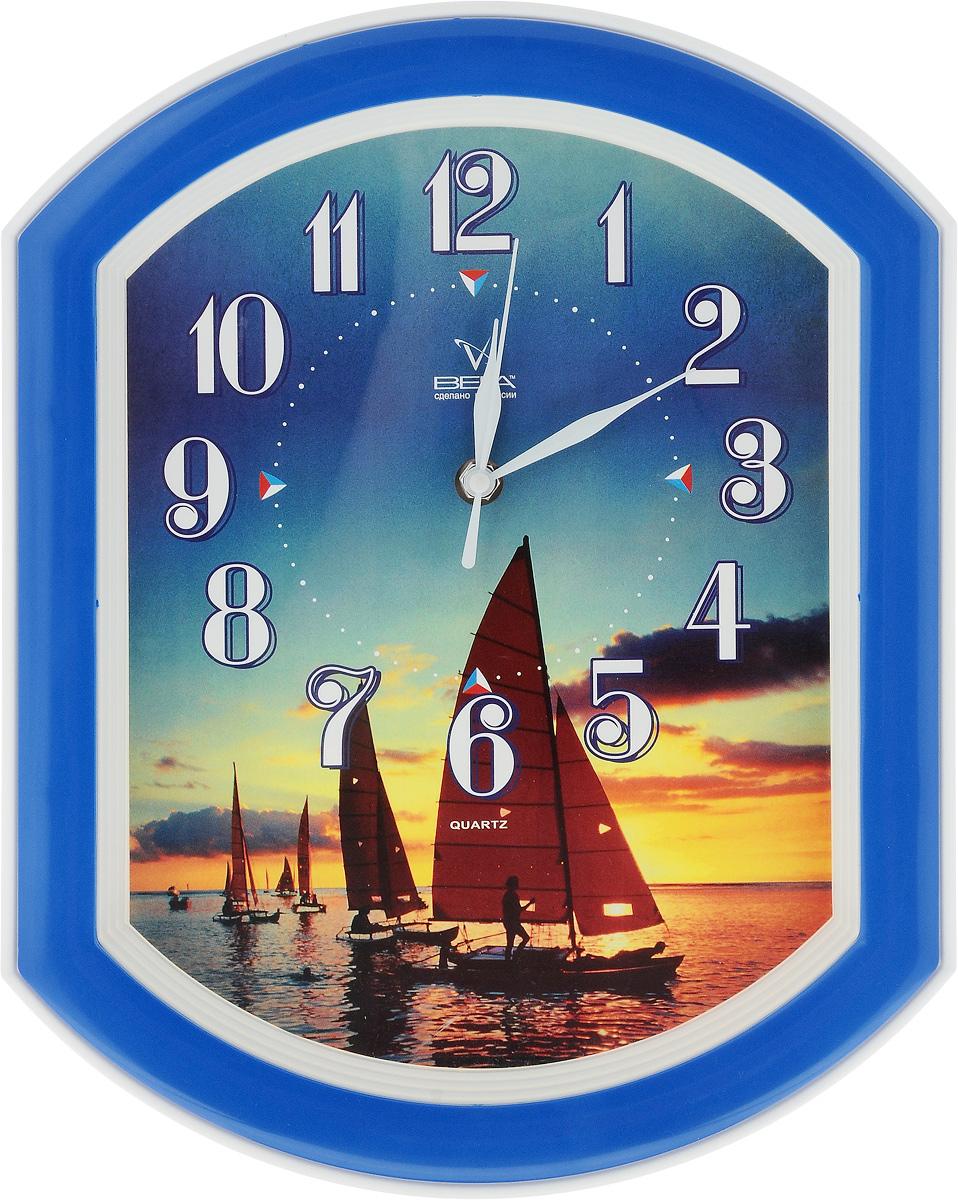 Часы настенные Вега Парусник, 34,5 х 27 смП2-10/7-14Настенные кварцевые часы Вега Парусник, изготовленные из пластика, прекрасно впишутся в интерьер вашего дома. Часы имеют три стрелки: часовую, минутную и секундную, циферблат защищен прозрачным стеклом. Часы работают от 1 батарейки типа АА напряжением 1,5 В (не входит в комплект). Прилагается инструкция по эксплуатации.