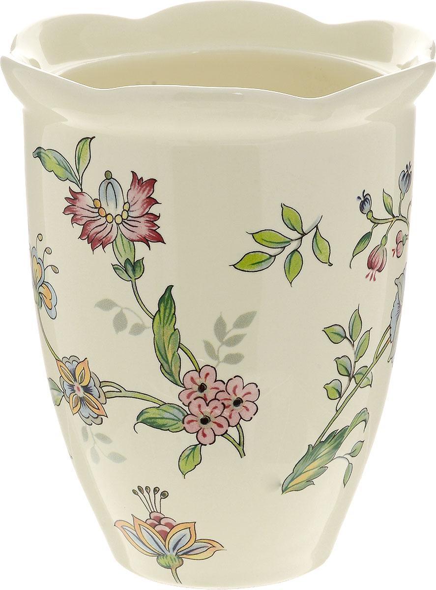 Ваза для цветов Nuova Cer Прованс, высота 15 смPRV-7372Ваза для цветов Nuova Cer Прованс изготовлена из высококачественной керамики и украшена цветочным узором. Такая оригинальная ваза прекрасно оформит интерьер дома, офиса или дачи. Подойдет как для декора, так и в качестве вазы для цветов. Нельзя мыть в посудомоечной машине. Высота вазы: 15 см. Диаметр по верхнему краю: 13 см. Диаметр дна: 7 см.